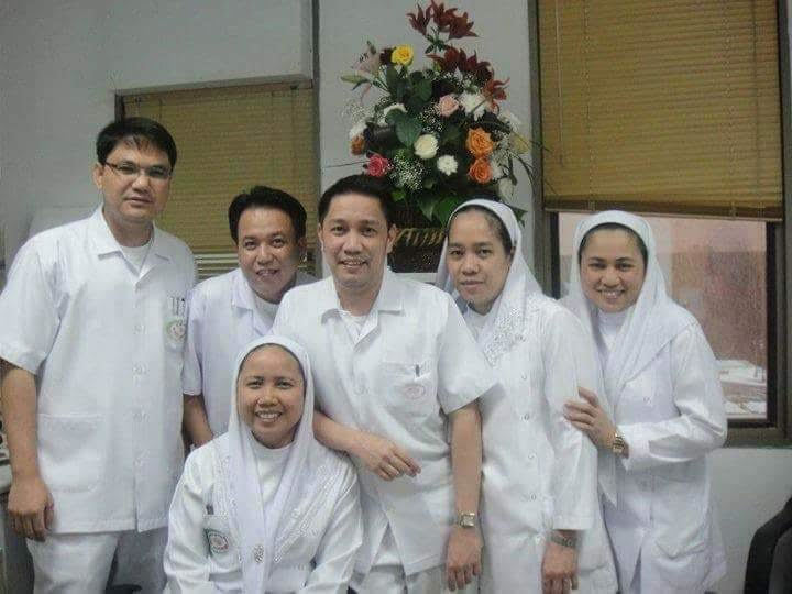 Care-home worker Warlito Valdez, left, with his co-workers in Saudi Arabia. Valdez later moved to B.C. and was employed as a residential worker helping people with intellectual and physical disabilities in Richmond, B.C. He died on April 5, 2020 after being exposed to COVID-19 on the job.(Minerva Rivera)