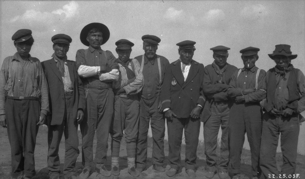 Chief Antoine and other Łı́ı́dlı̨ı̨ Kų́ę́ First Nation Dene men at Fort Simpson in 1921. Conroy had told his superiors the Dene were eager to make a treaty, but the reality was that his treaty was met with deep skepticism across the North. (Oswald S. Finnie / Canada. Dept. of Indian and Northern Affairs / Library and Archives Canada / PA-100350)