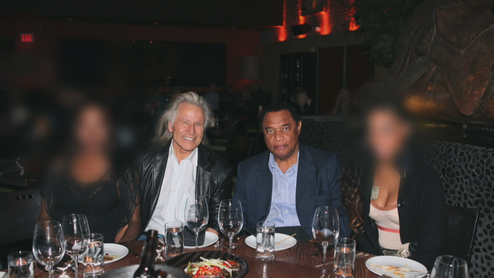 Nygard and former Bahamian prime minister Perry Christie in a Las Vegas restaurant with two young women. (Submitted by Stephen Feralio)