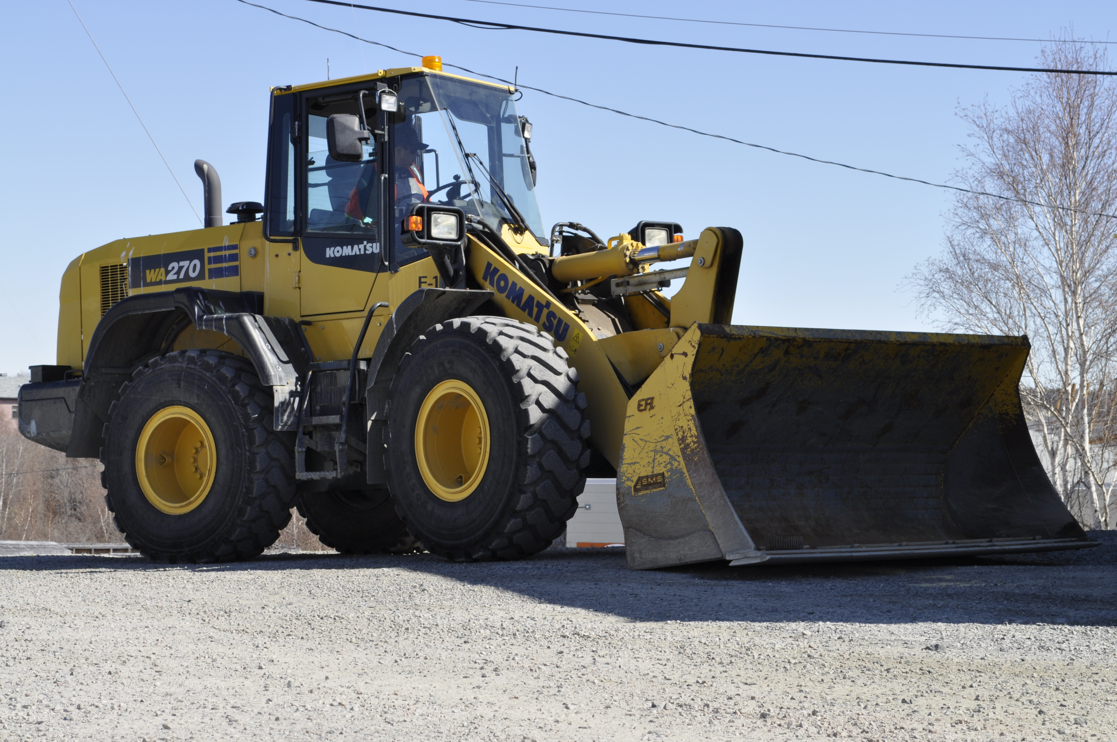 Paul Betsina operates a loader at the Det'on Cho facility in Ndilo. The business arm of the Yellowknives Dene is itself a major employer in the territory. (Alex Brockman/CBC)