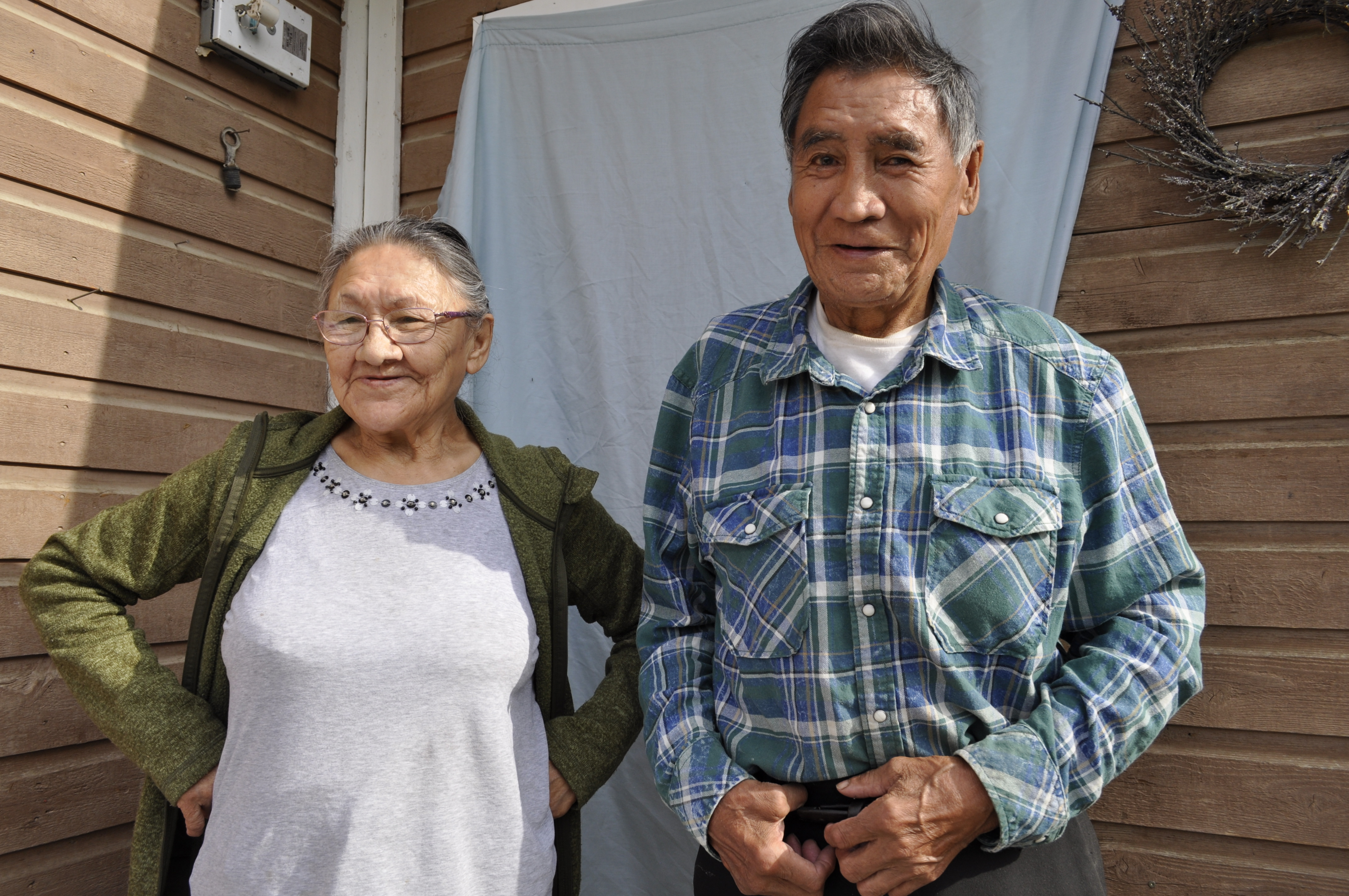 Margaret and Edward Kelly have lived in their home in Fort Good Hope, N.W.T., for 30 years. It's falling apart, and they blame the permafrost shifting beneath their feet. (Alex Brockman/CBC)