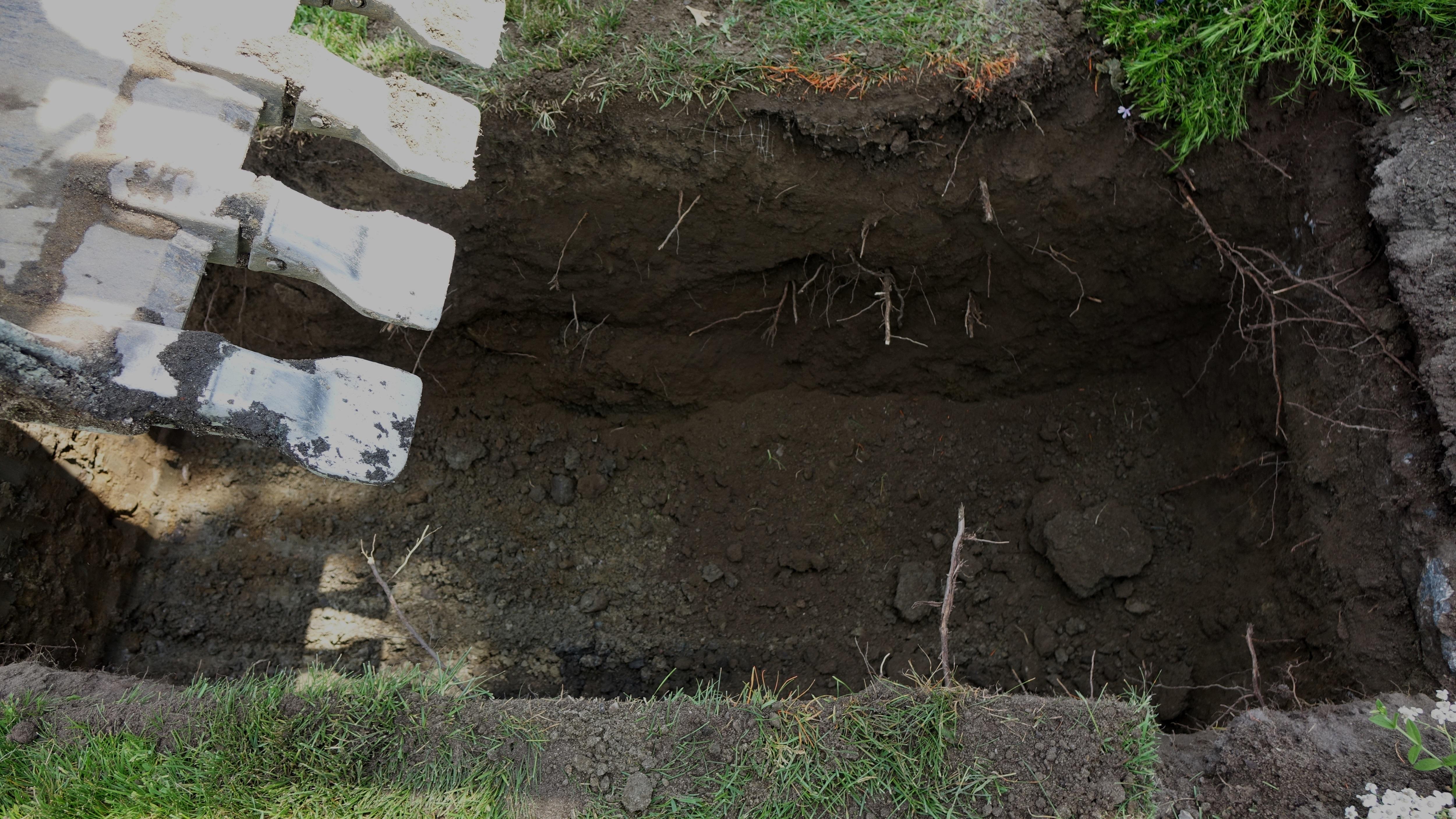 A partially dug grave at Beechwood Cemetery. (Miriam Katawazi/CBC)