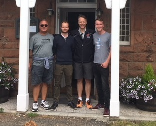 David Brand, second from left, and Nick Brand, right, took a photo with Lt.-Gen. Al Meinzinger, second from right, outside the Brands' Blackwaterfoot Lodge after an unlikely meeting. (Submitted by David Brand)