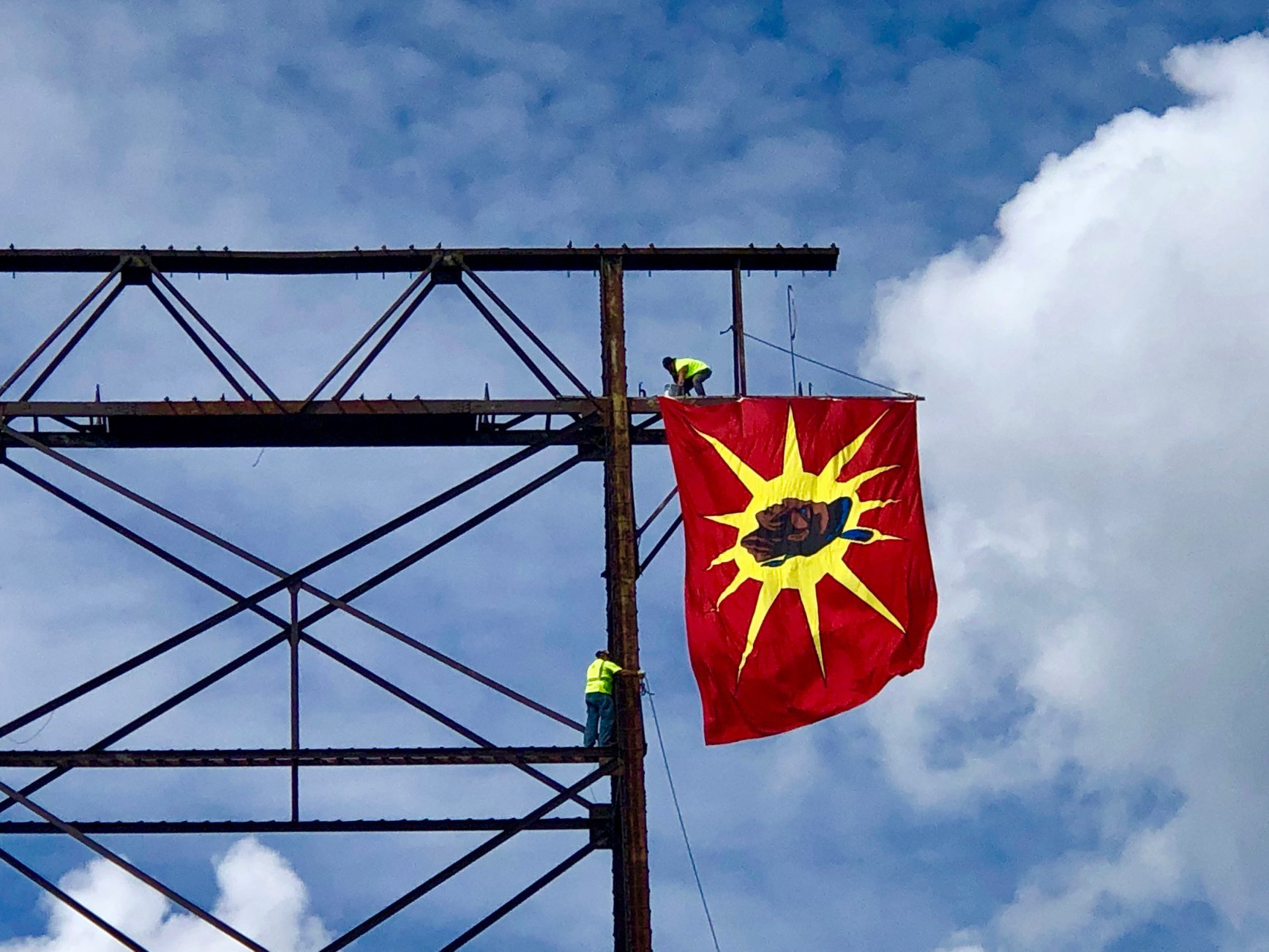 In 2019, several large-scale flags were hung off the Honoré Mercier Bridge in Kahnawake, Que., to commemorate the 29th anniversary of the Oka Crisis. (Submitted by Deidre Diome)