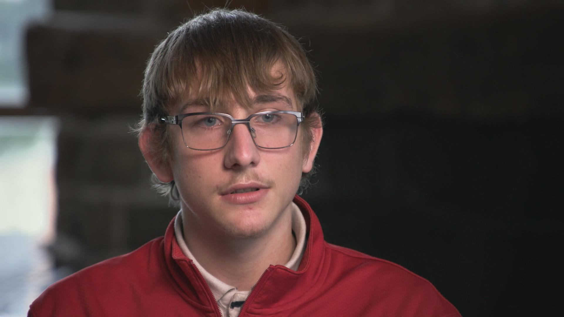 Ethan Moore says it was hard to understand what was going on when police raided his home because he and his brothers were so young. (Andy Hincenbergs/CBC)