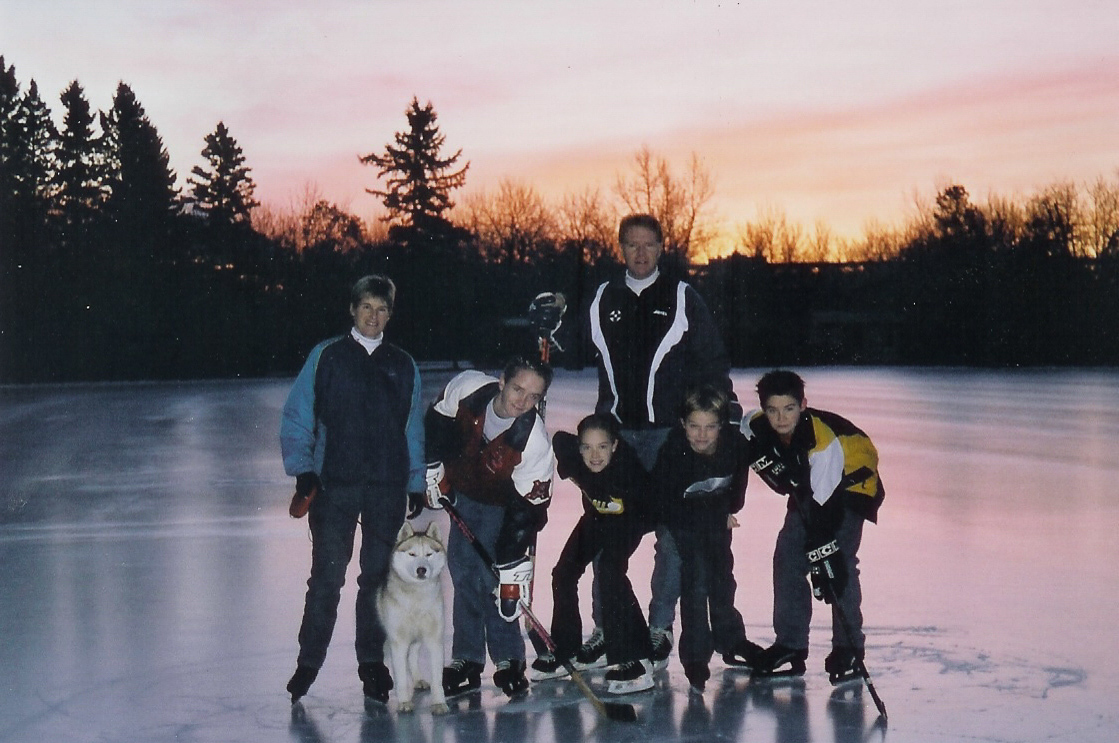 The young Gregg family at Victoria Oval in Edmonton, with their family dog Kolya. (Supplied by Kathy Gregg)