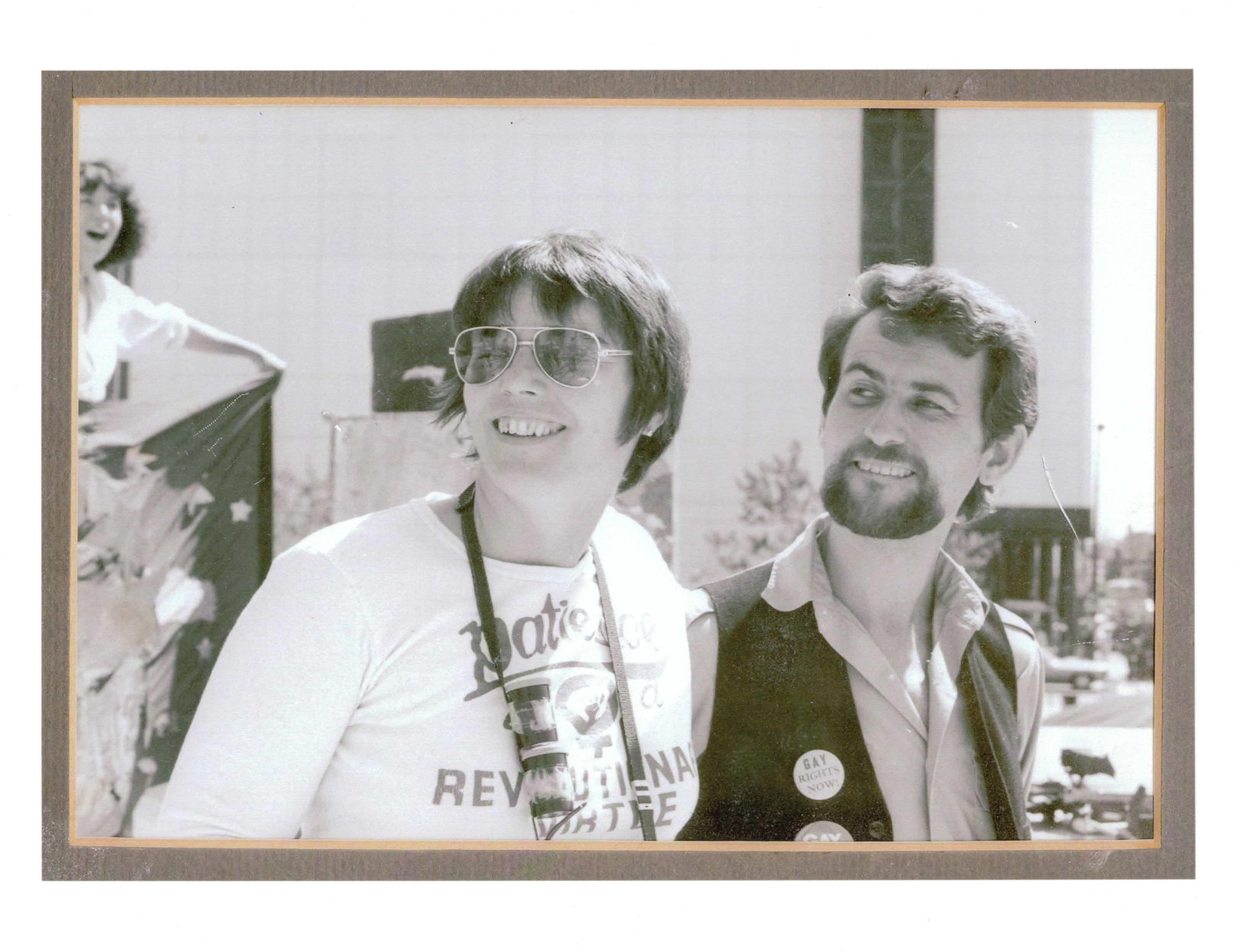 Don Hann, right, with feminist Cy-Thea Sand at a rally against violence, circa 1979. (Don Hann)