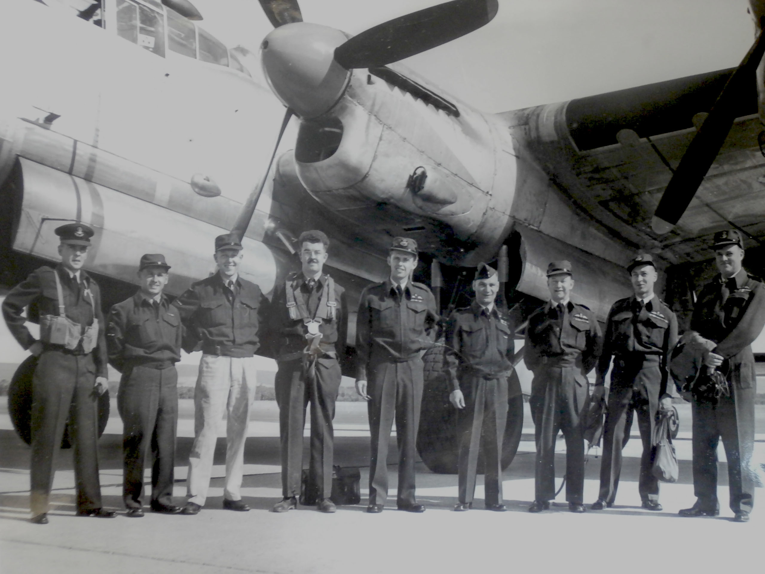 The flight crew of Lancaster 965 is shown in this photo, taken shortly before the crash. Flying Officer James McCutcheon is pictured in the centre, fifth from the left. (Submitted by Richard Mayne/RCAF)