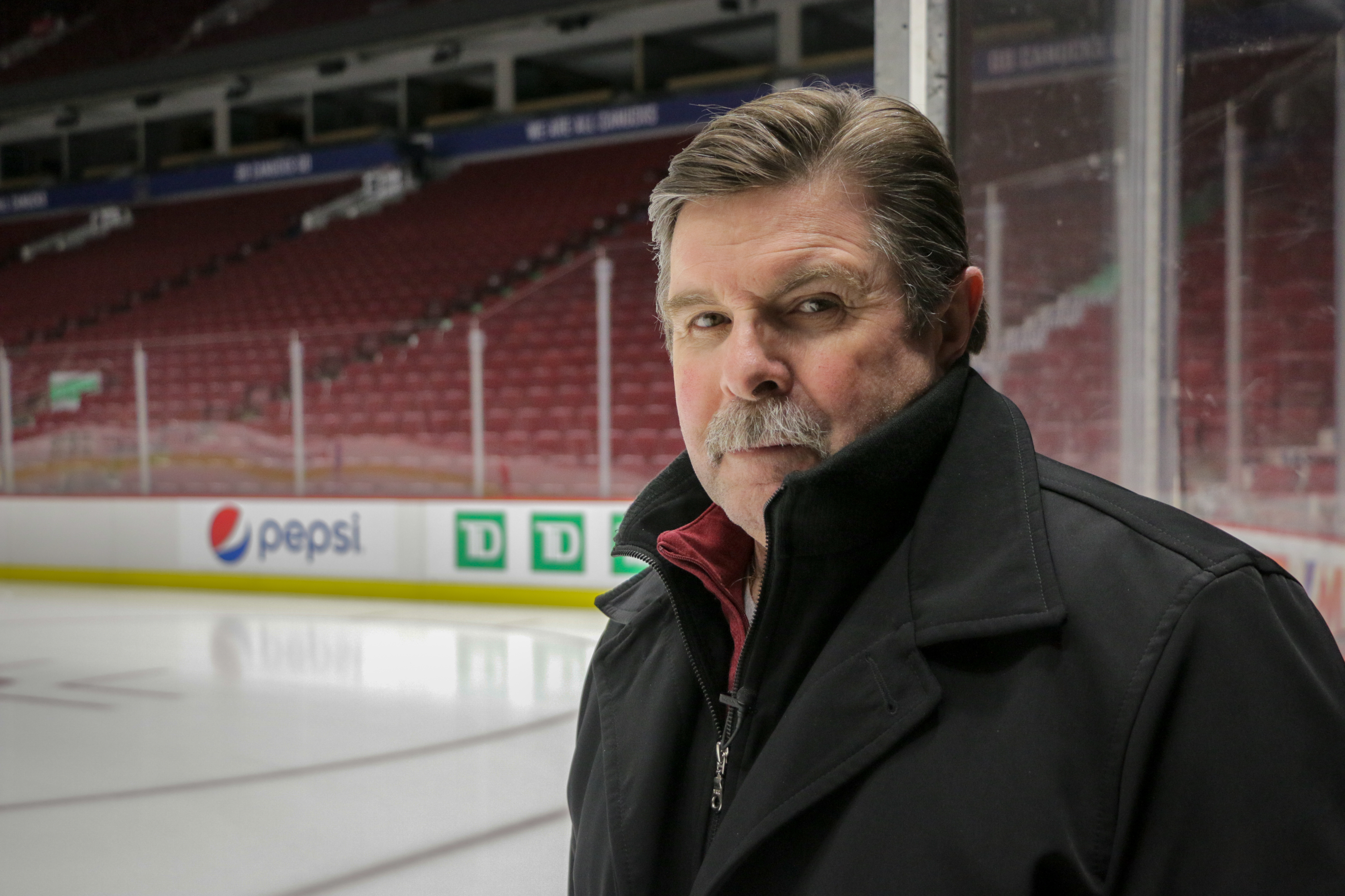 Referee Bill McCreary at Vancouver's Rogers Arena in 2019. During the 2010 Olympics, the arena was known as Canada Hockey Place. Over McCreary's right shoulder is the rink corner he was in when Sidney Crosby scored the golden goal. (Christian Amundson/CBC)