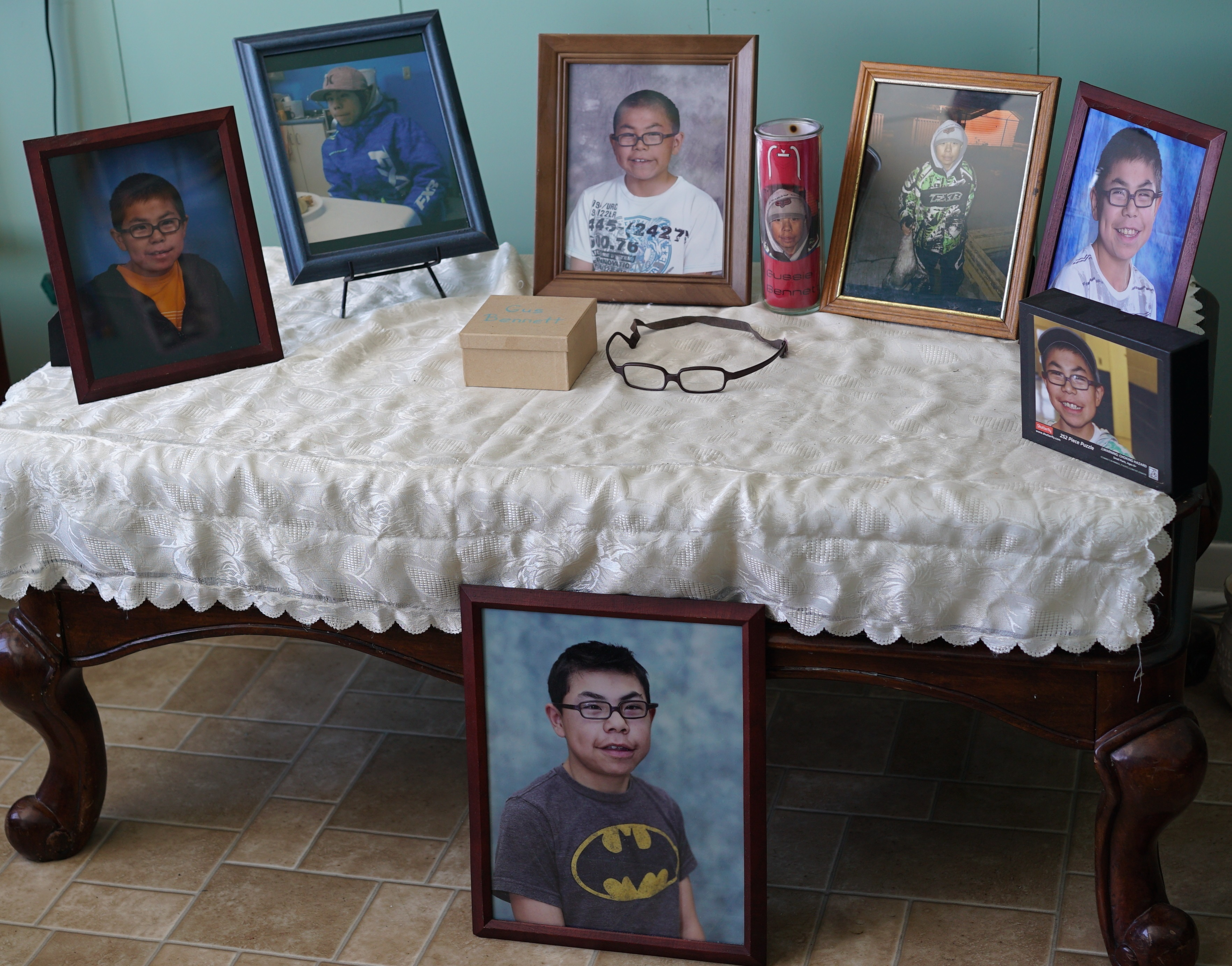 Photos of Gussie Bennett in his family's home in Nain. (Ossie Michelin/CBC)