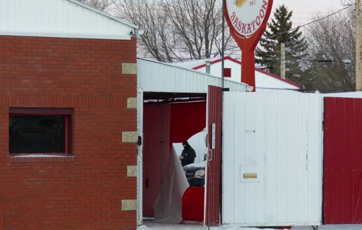 Police inside the Hells Angels compound in Saskatoon during the raid. (Dan Zakreski/CBC)