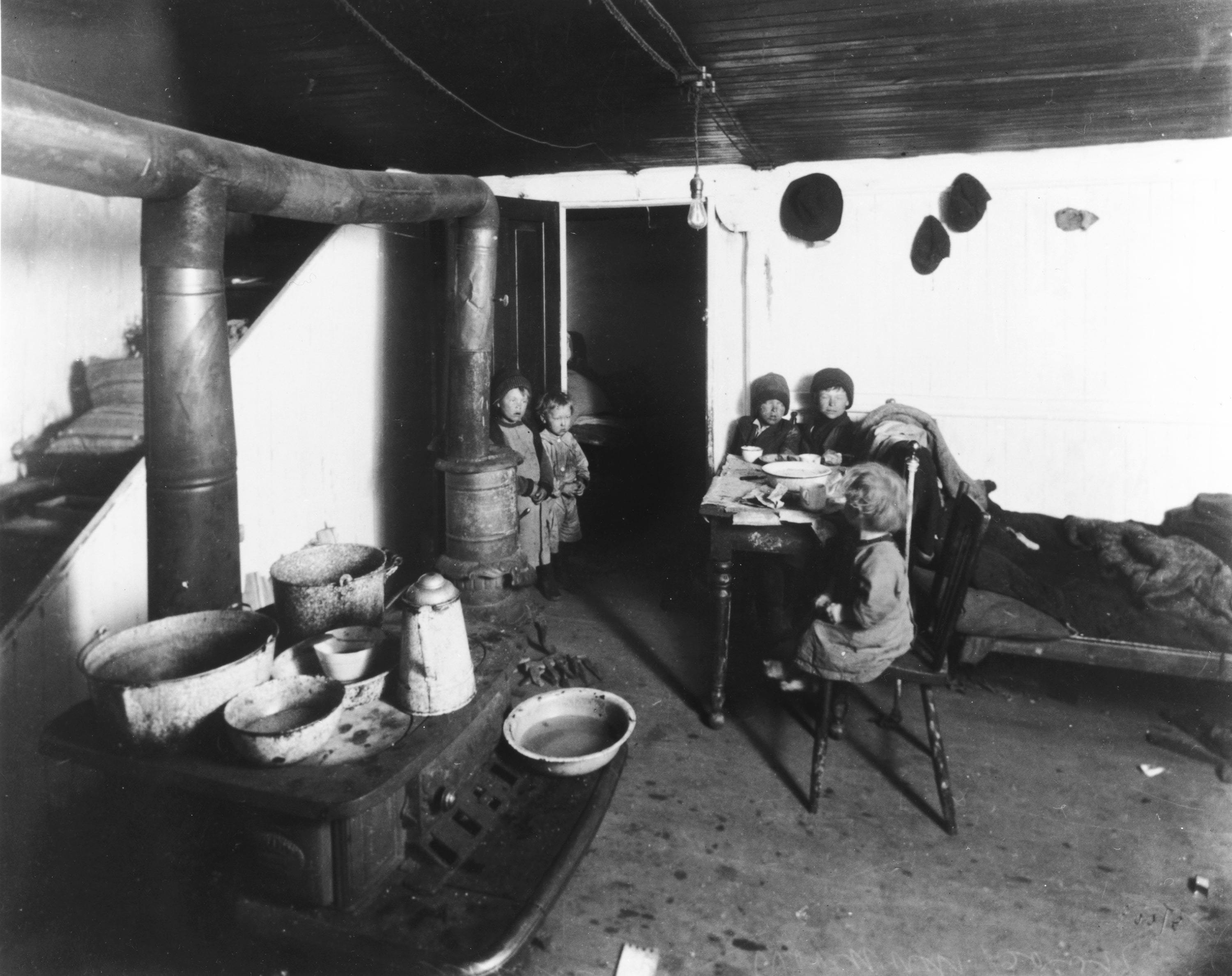 Children live in poor housing around 1916. (Archives of Manitoba)
