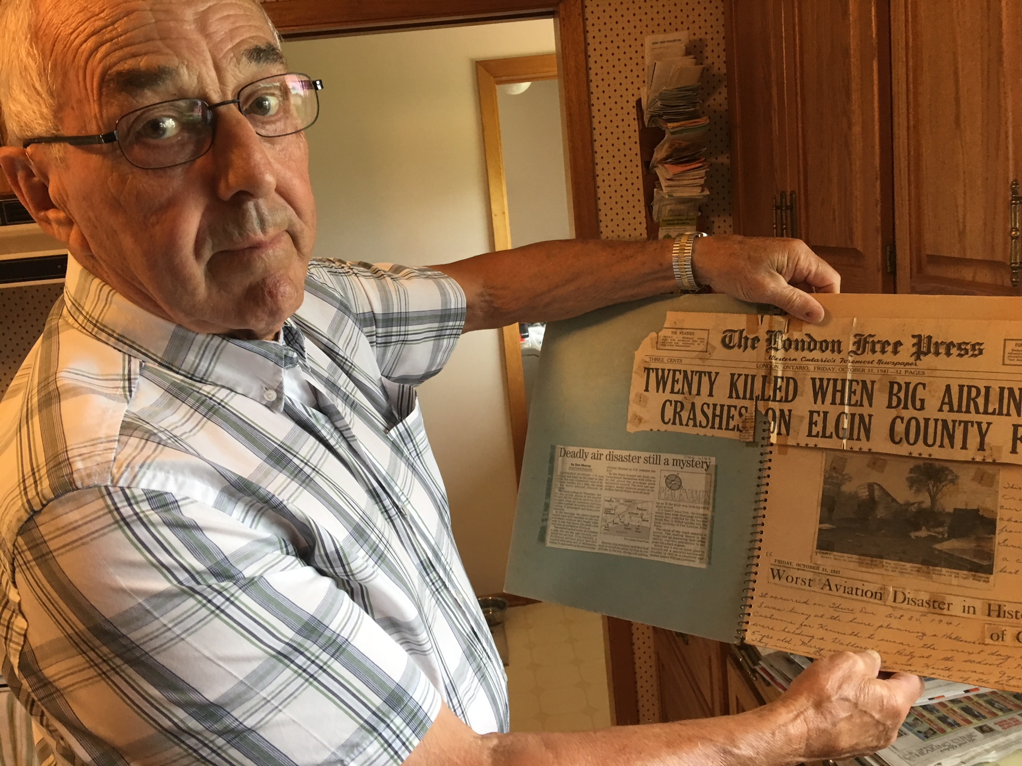 Ken Howe was five years old when the plane came down on his family's farm on the night of Oct. 30, 1941. His family's house became a makeshift operations centre for crash investigators and journalists in the days that followed. (Andrew Lupton/CBC)