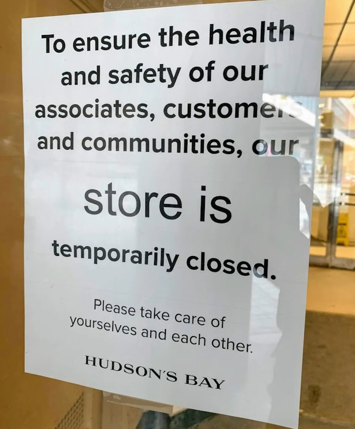 Signs were posted in windows at many businesses, like this one in March at Winnipeg's downtown Hudson's Bay store. (Darren Bernhardt/CBC)