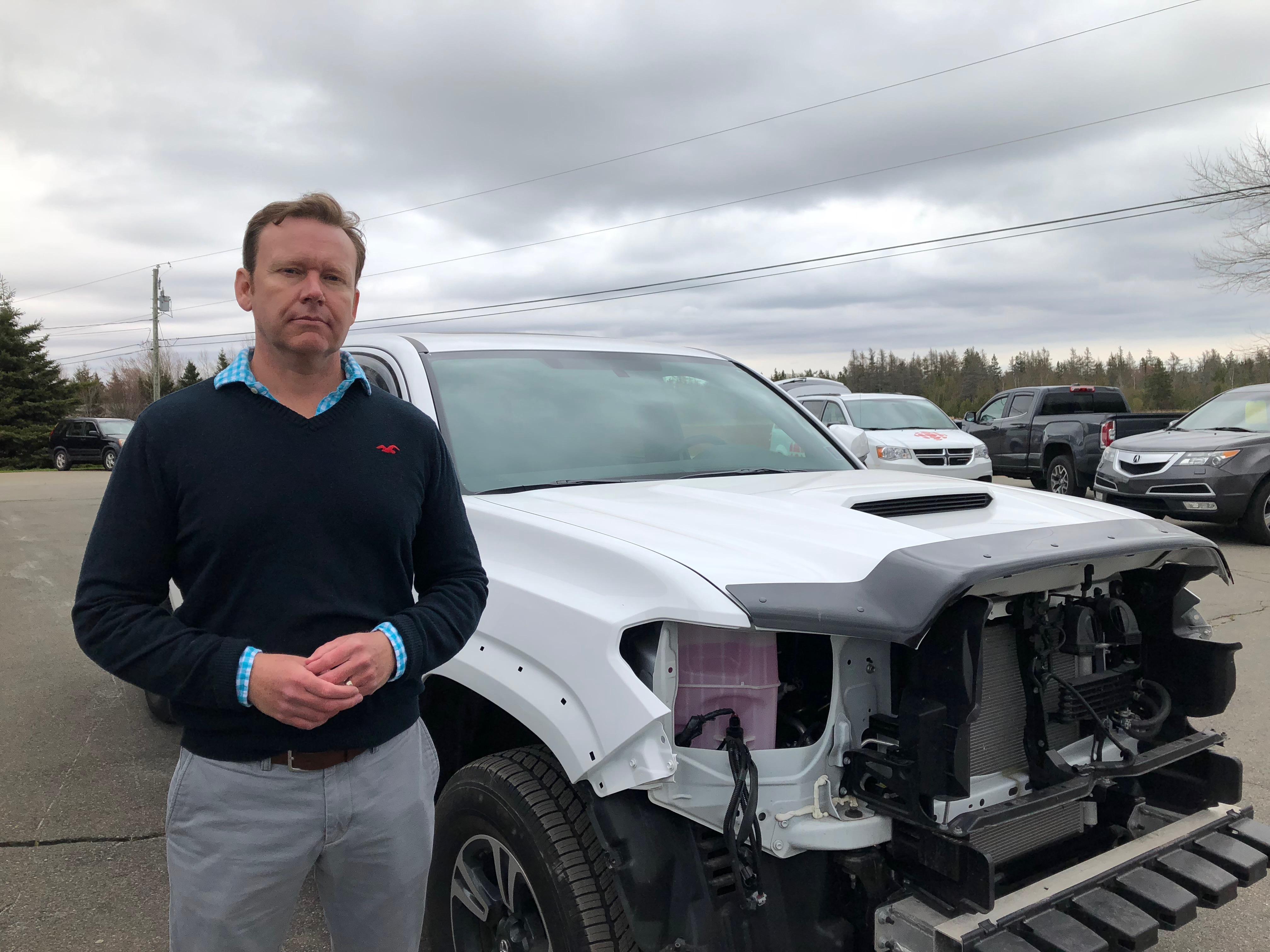 Sam Dalton's new Toyota Tacoma sustained $9,200 in damage. (Sally Pitt/CBC)