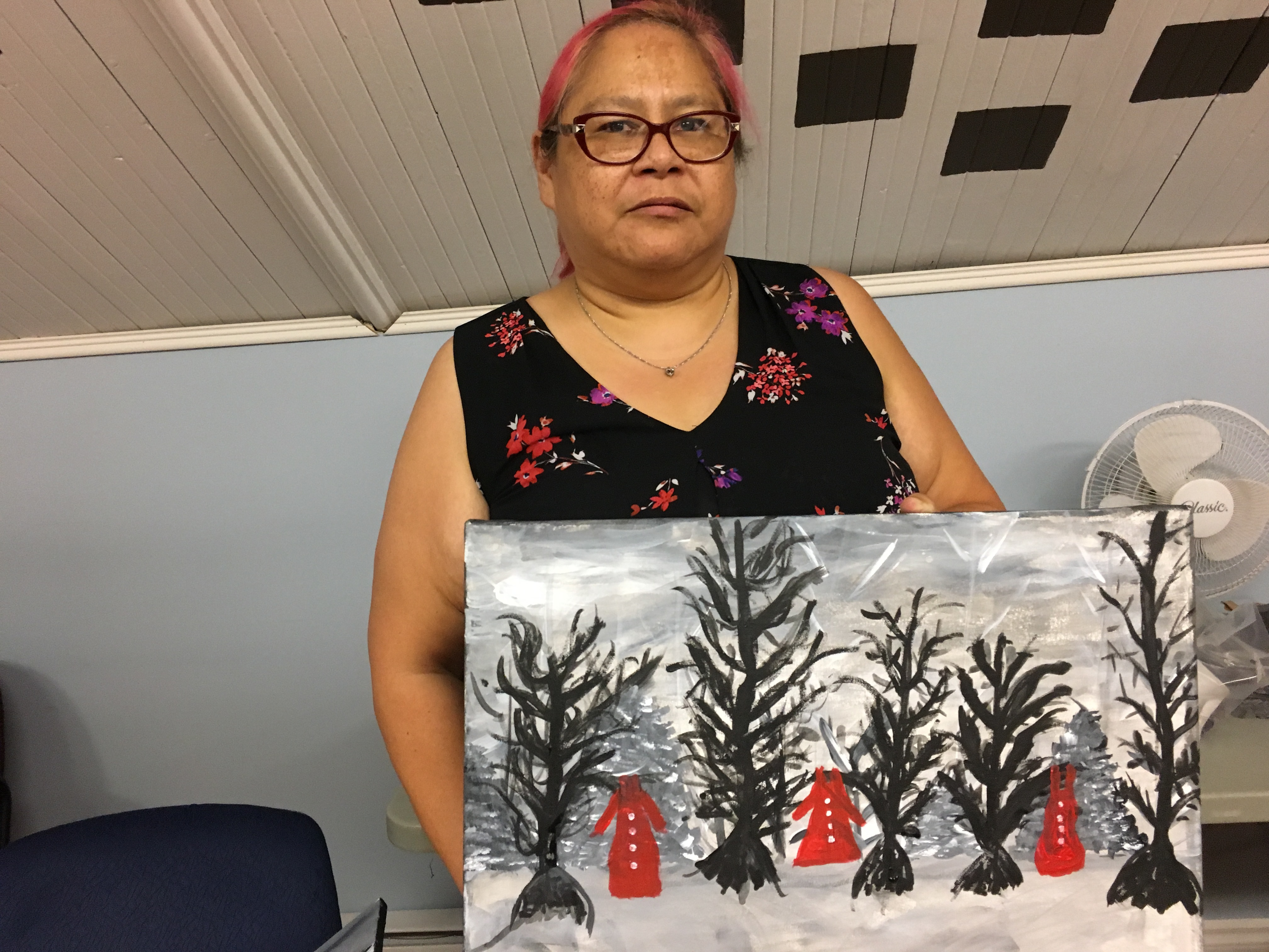 Patsy Gavin stands with her completed painting. (Natalia Goodwin/CBC)