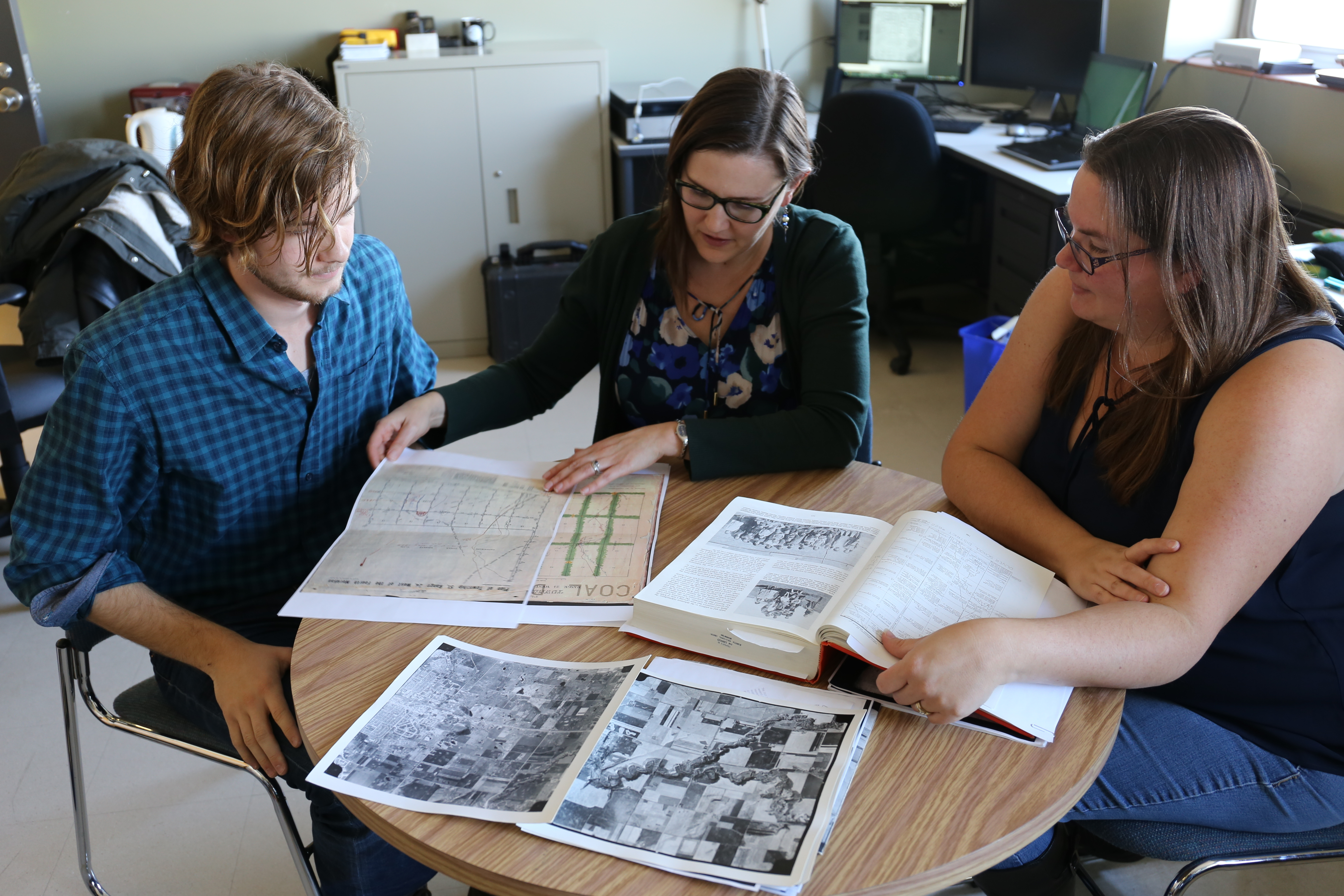 Kisha Supernant, centre, is working with University of Alberta students William Wadsworth, left, and Kathy Gadd, right, to find Papaschase burial sites. (Stephanie Dubois/CBC)