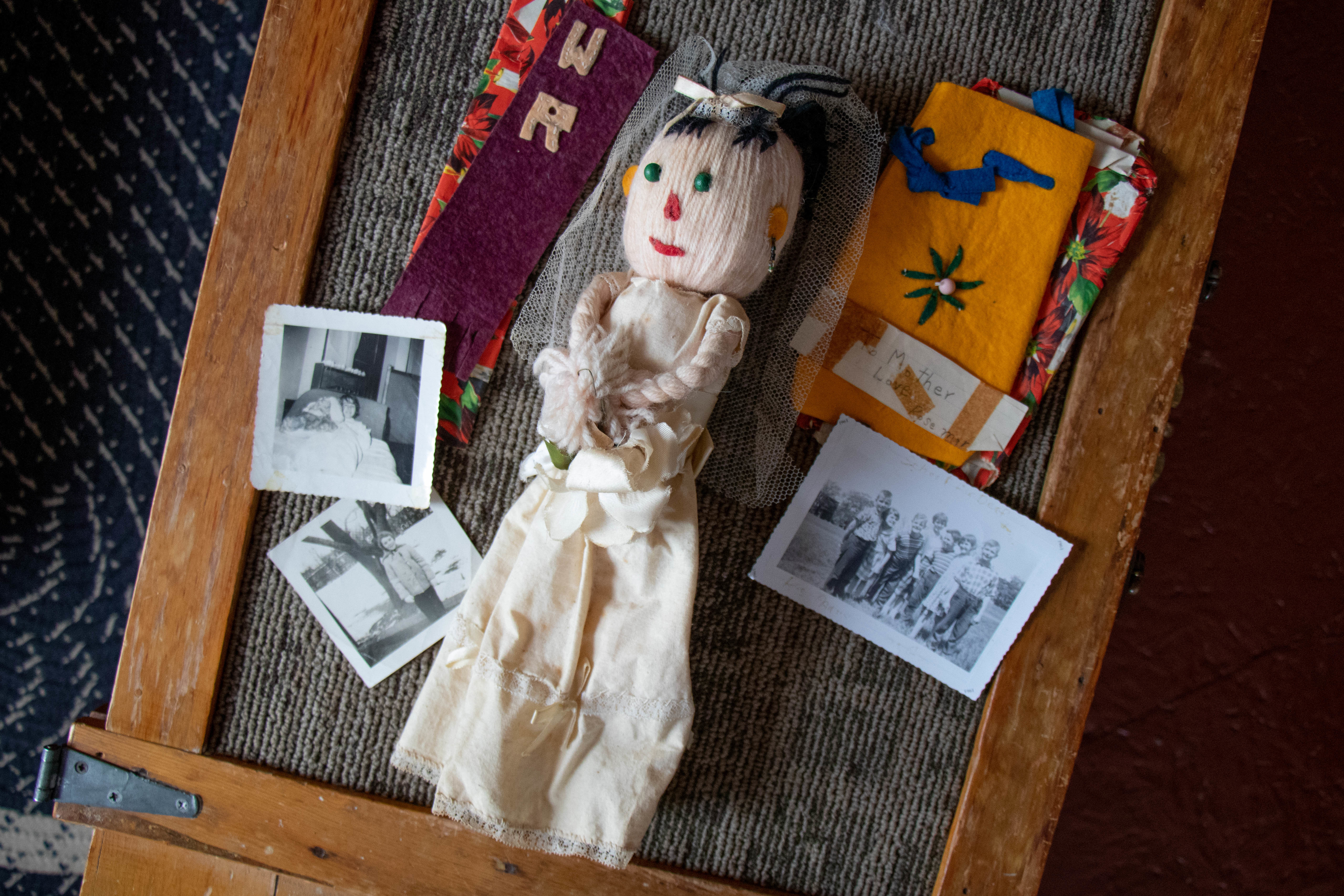This doll is one of the few things Ross-Brimble has kept from her time at the deaf schools. (Robert Short/CBC)