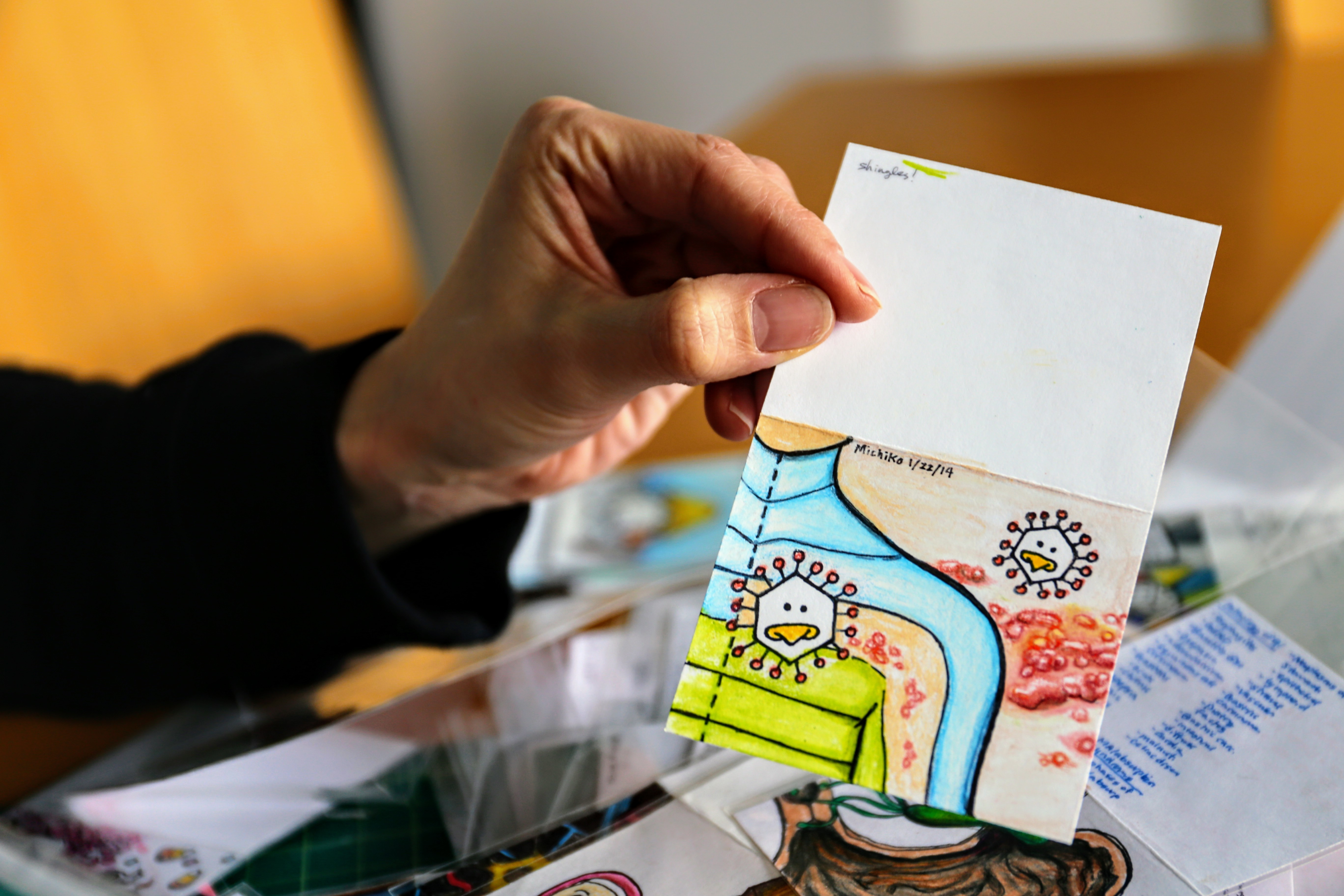 Maruyama uses medical doodles to promote art and medicine. (Emily Rendell-Watson/CBC)