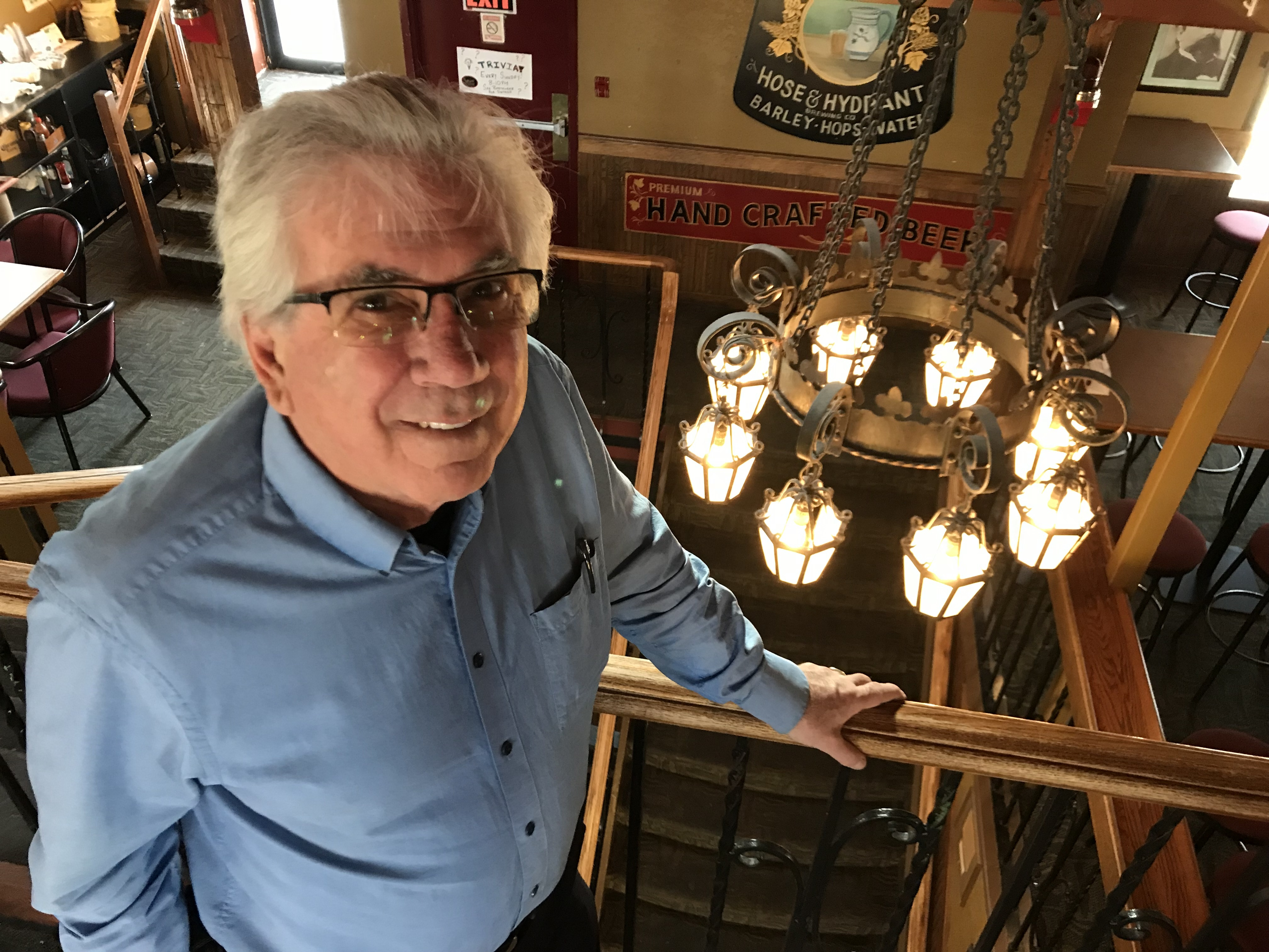 """""""They were just sitting in this warehouse, gathering dust, of no value to anyone else,"""" says Ken Achs of Capitol chandeliers he incorporated into the Hose and Hydrant restaurant. (Guy Quenneville/CBC)"""