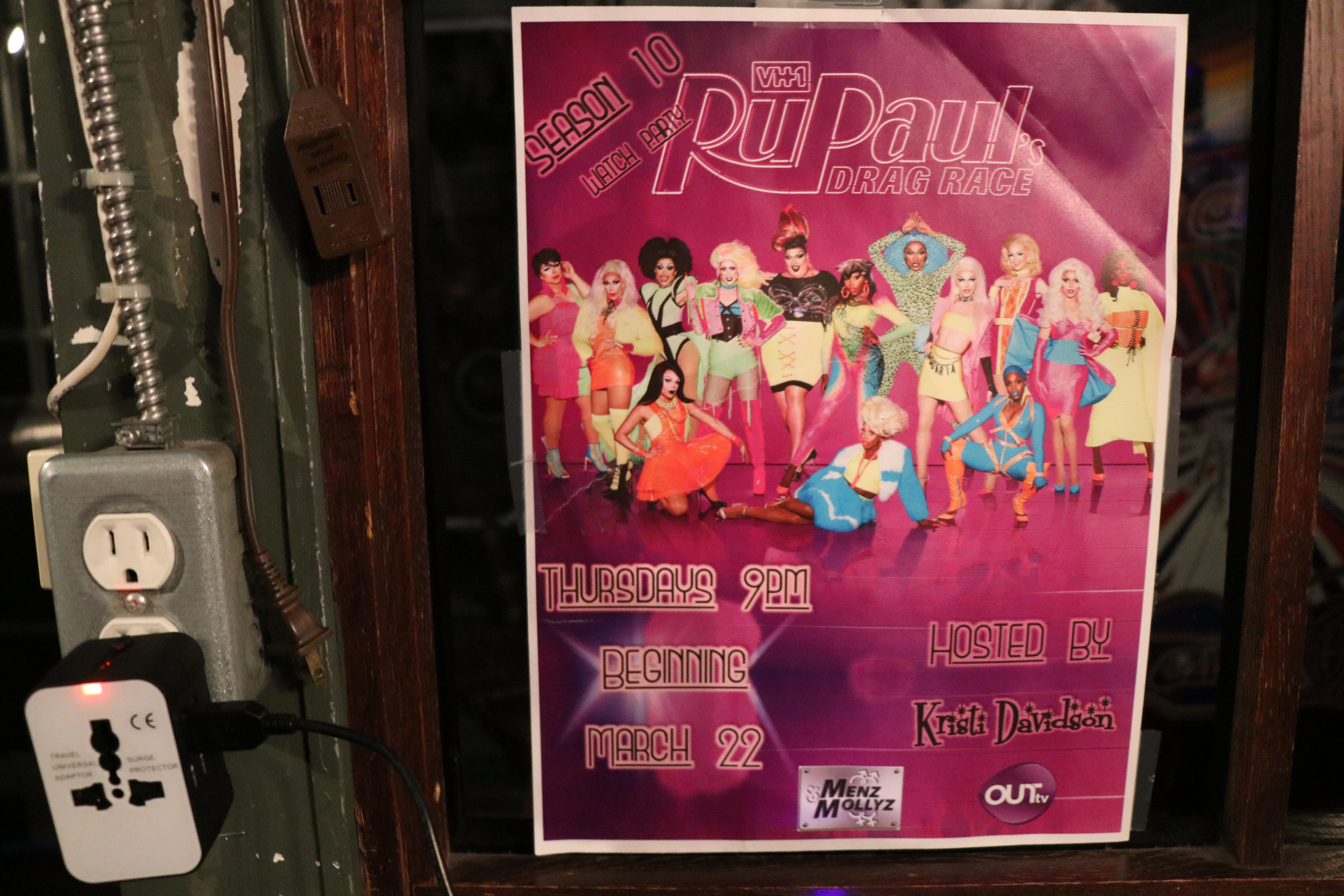A poster for RuPaul's Drag Race at Menz & Mollyz Bar in Halifax. (Emma Davie/CBC)