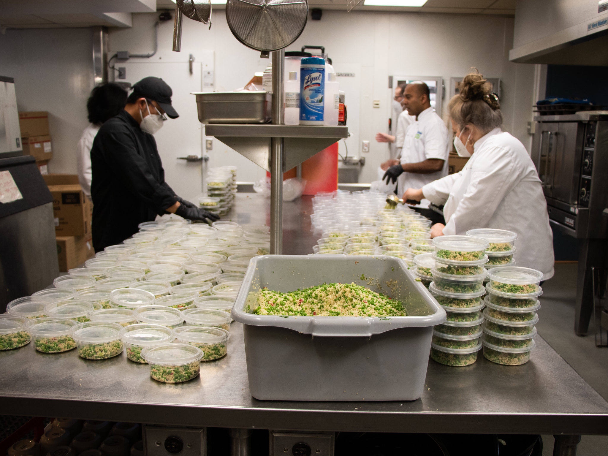 Tight quarters in the kitchen at the Langara Golf Course clubhouse mean staff find it hard to keep a safe distance from one another, but they hope that masks and frequent disinfecting helps.