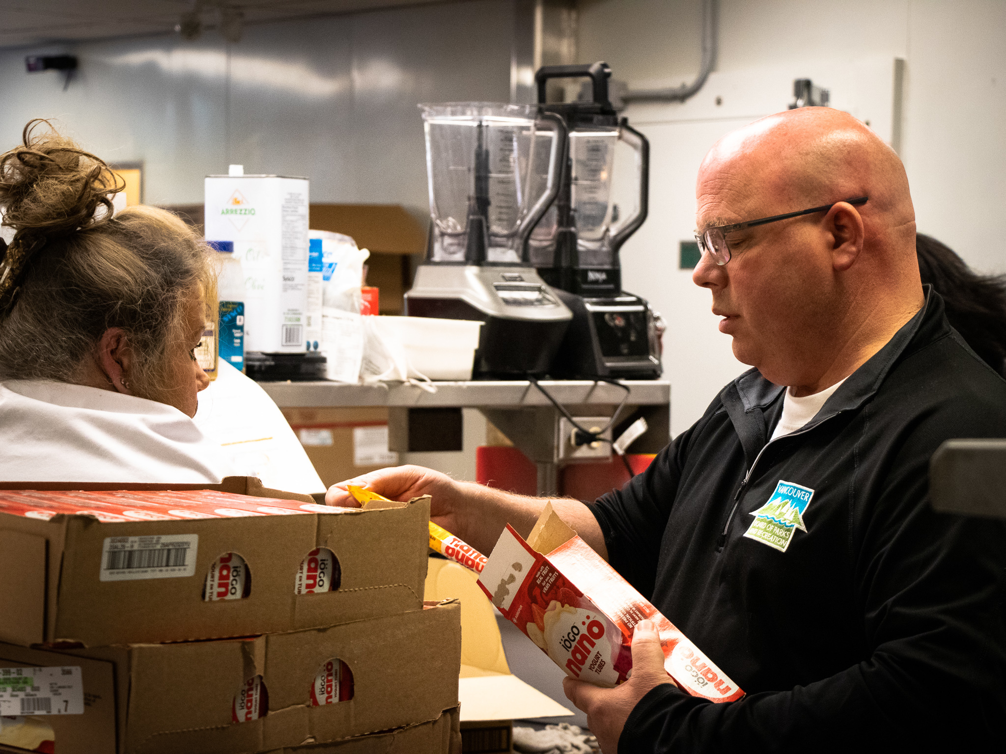 Mark Halyk (right) is in charge of the hamper program. His job includes sourcing nutritious, low-cost food.