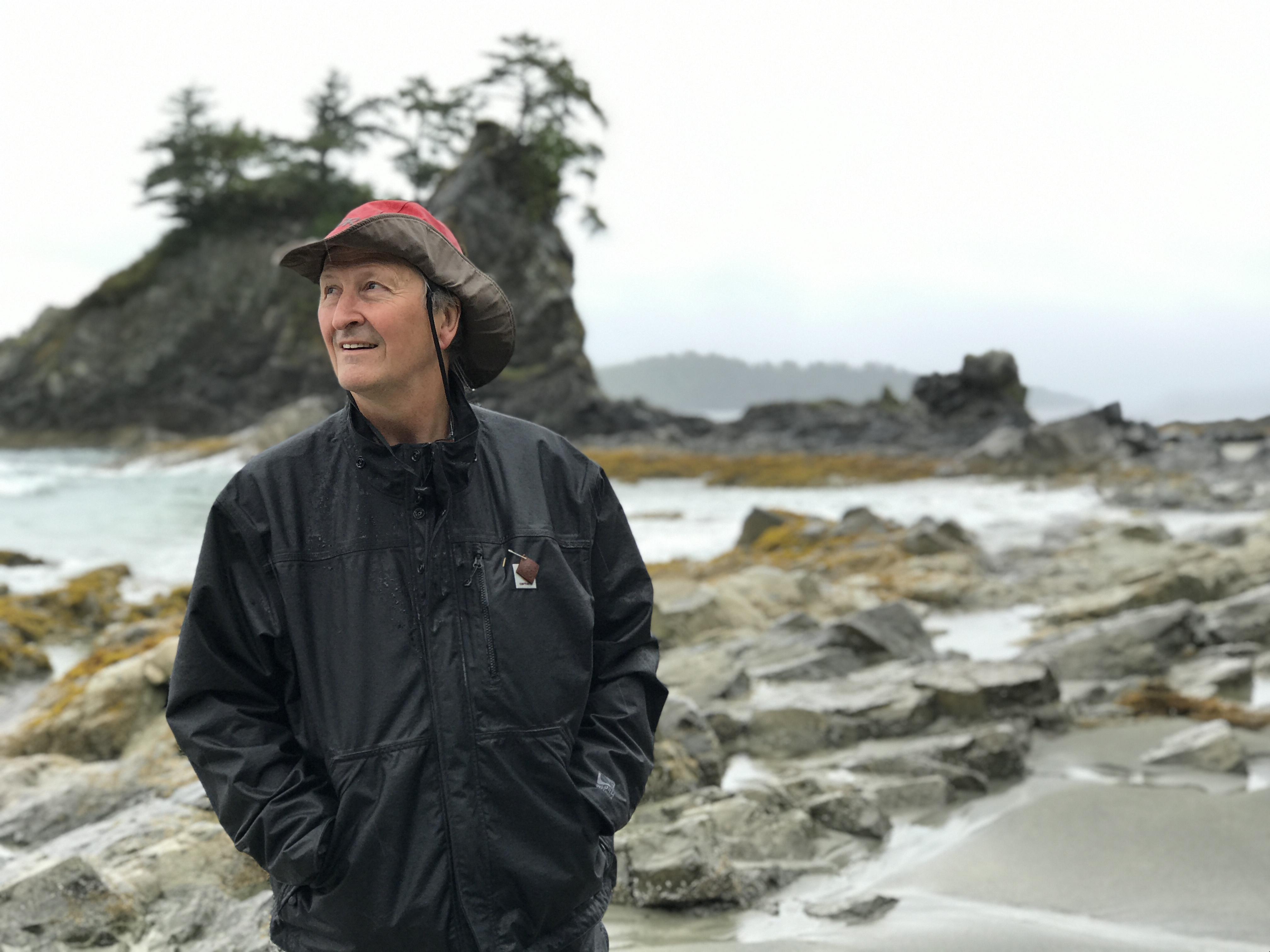Keith Wyton, a Bamfield resident since 1979, watches an eagle fly away at Brady's Beach. (Megan Thomas/CBC)