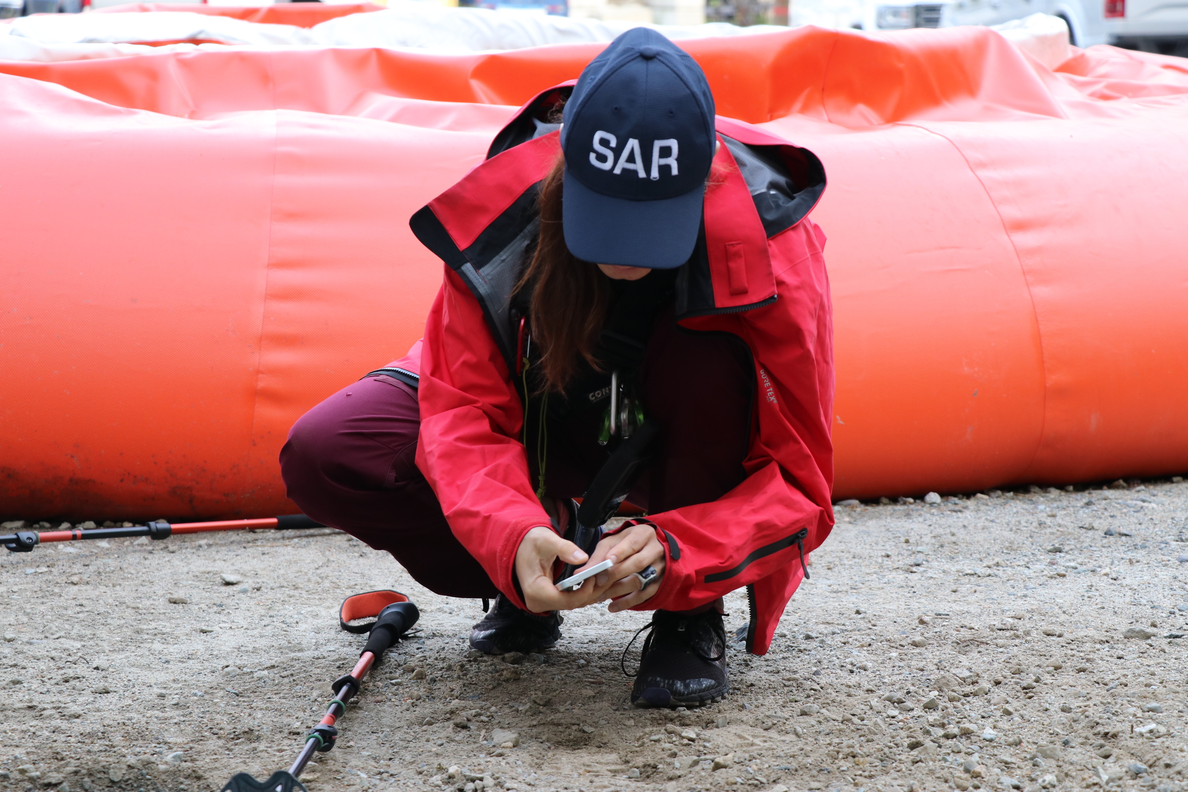 Maria Masiar captures a photo of the footprint with her phone as part of the training exercise. (Clare Hennig/CBC)