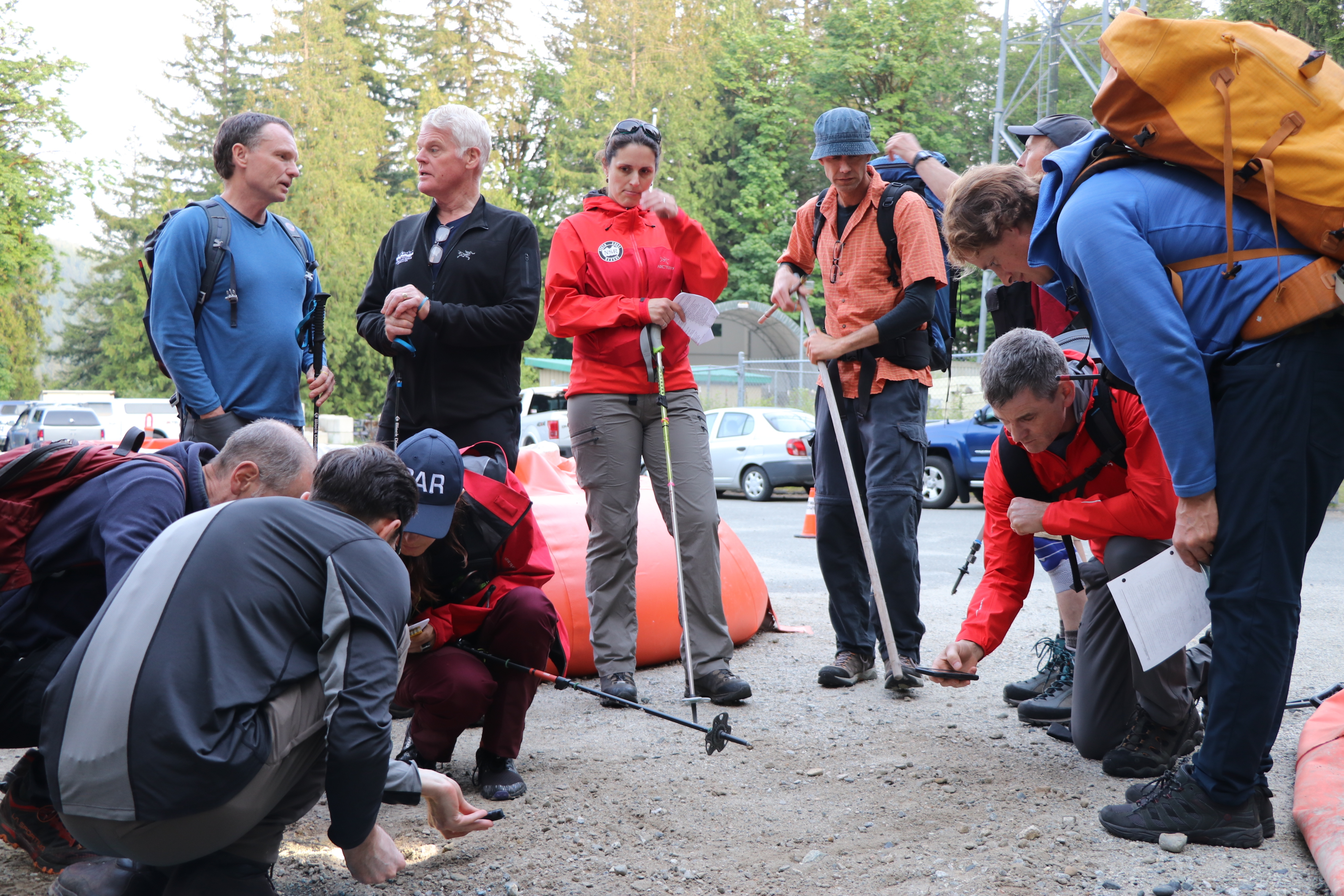 The group of North Shore Rescue volunteers gathered for a weekly 'Tuesday Training' session near the Lower Seymour Conservation Reserve in North Vancouver, in an area closed to the public. (Clare Hennig/CBC)