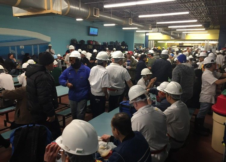 Workers gather in the cafeteria prior to the COVID-19 outbreak. After dozens of employees fell ill at Cargill, the company said it would begin staggering break times. (Submitted by name withheld)
