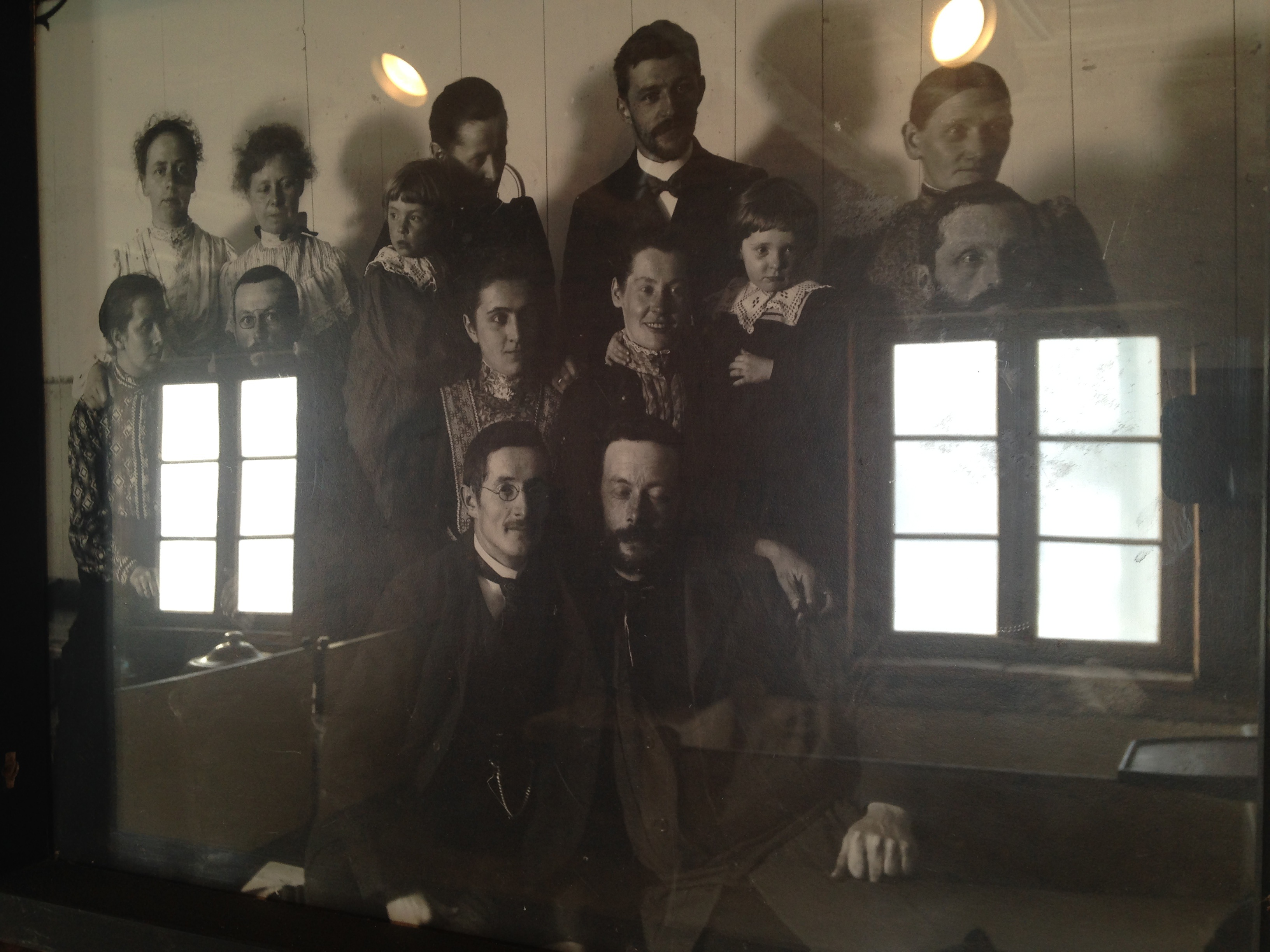 The windows of the mission building are reflected in the faces of missionaries. (Angela Antle/CBC)