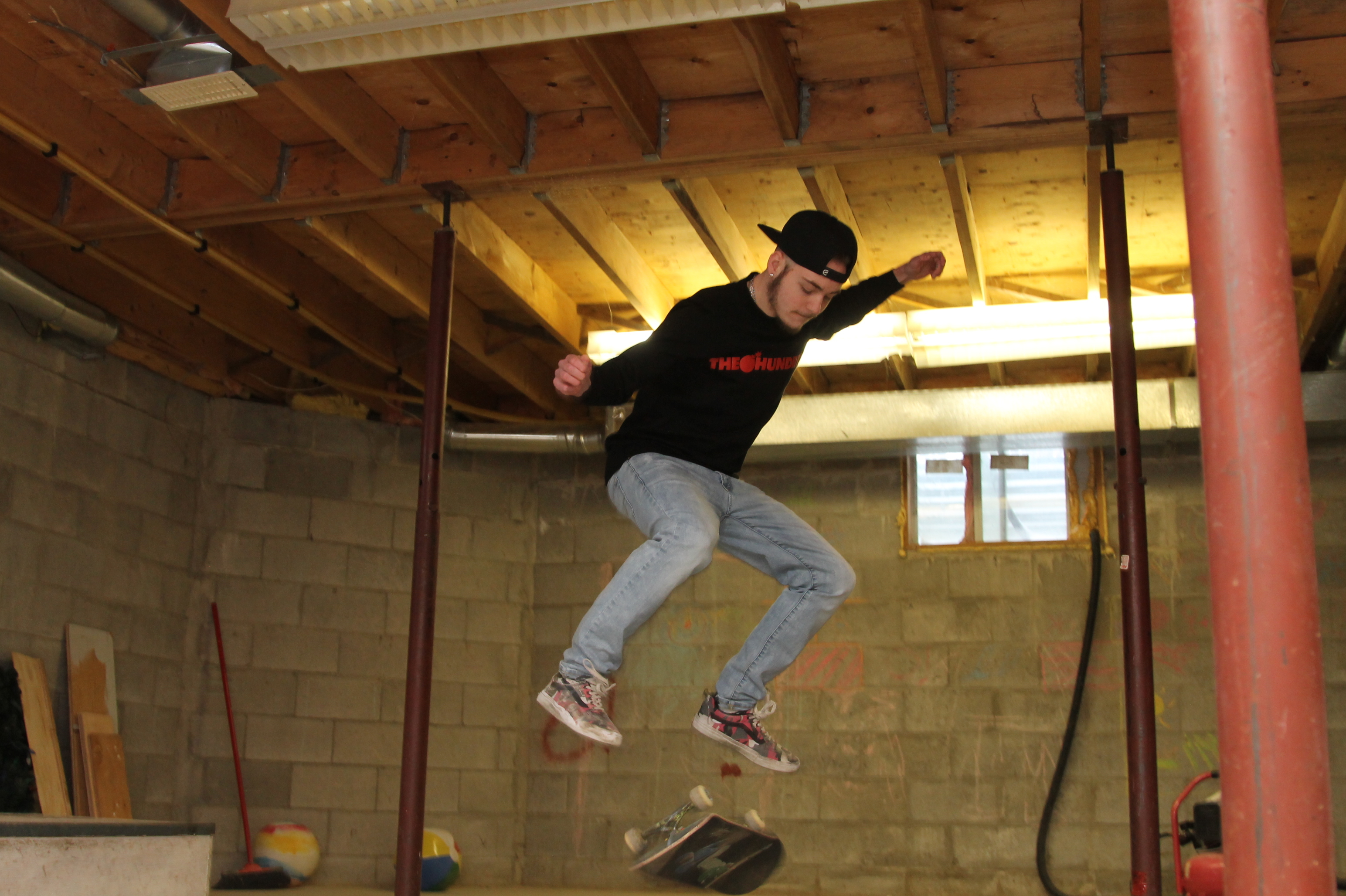 Skateboarding is a huge part of Kian's life and he's set up a skate park in his basement. (Stu Mills/CBC)