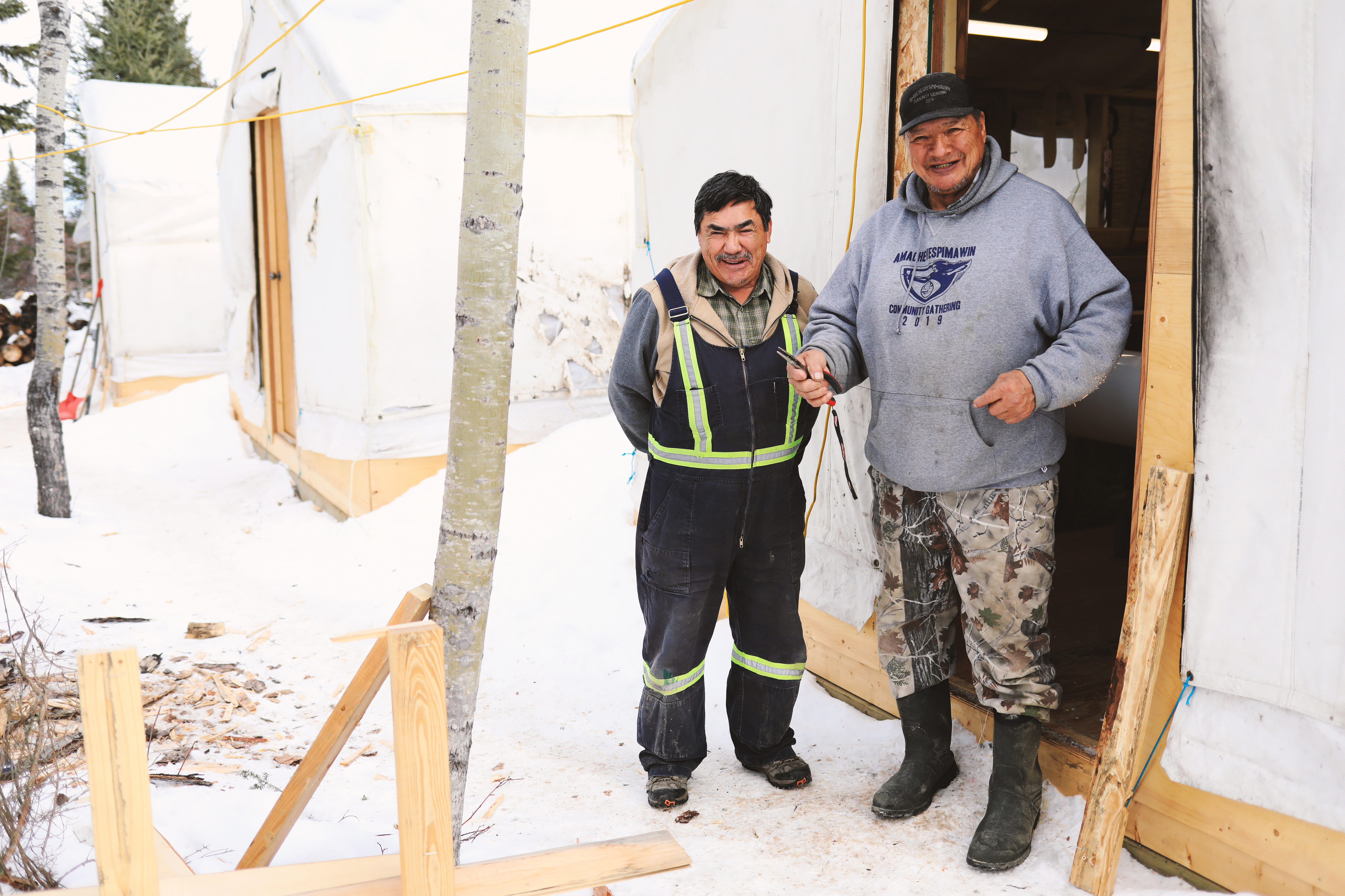 Elders Peter Roberts and Isaiah Roberts work out at the land-based site to teach the students traditional skills. (Heidi Atter/CBC)