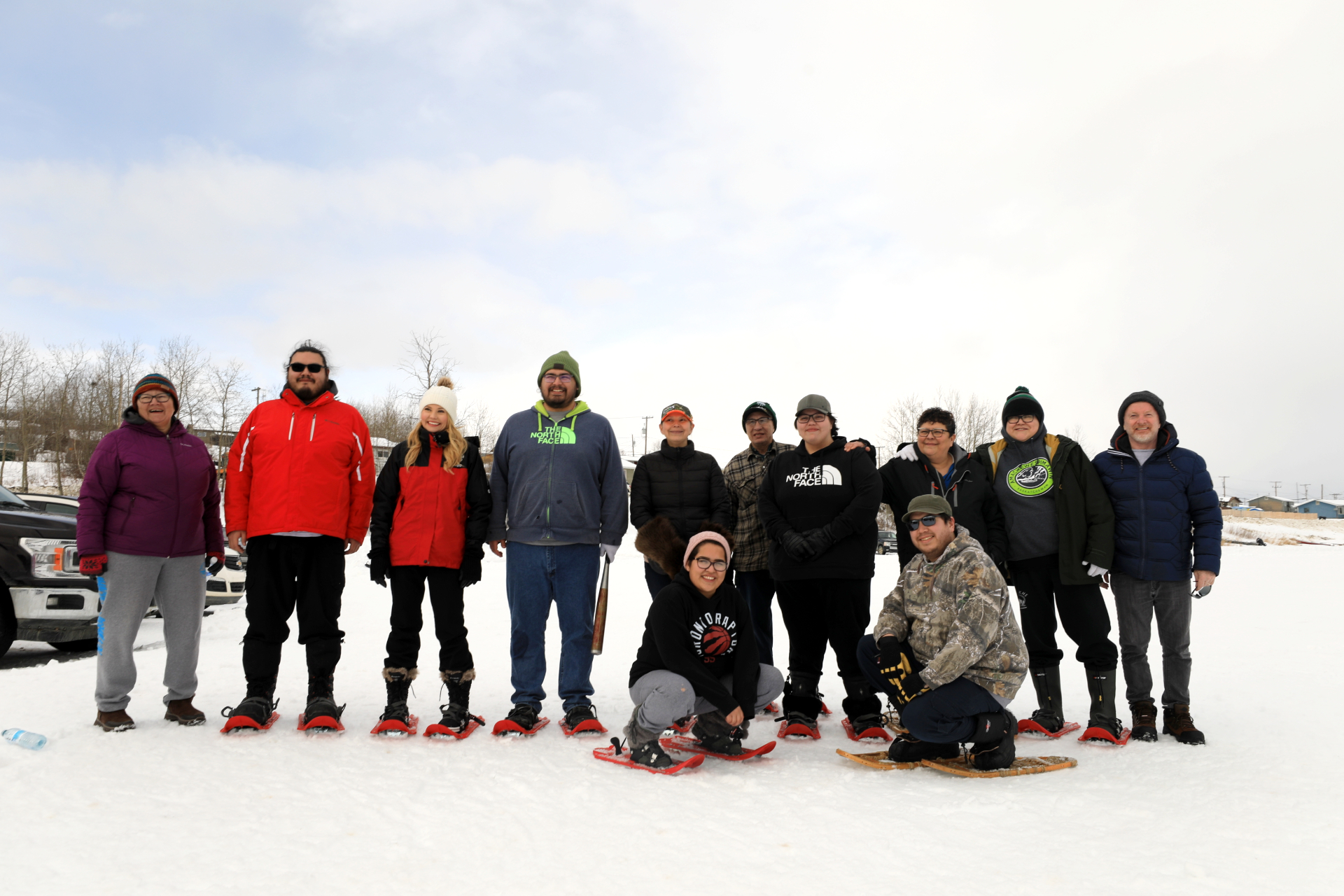 The Rhoda Hardlotte Memorial High School snowshoe baseball team poses for a picture on the frozen Churchhill River before stepping up to bat on February 28, 2020. (Heidi Atter/CBC)