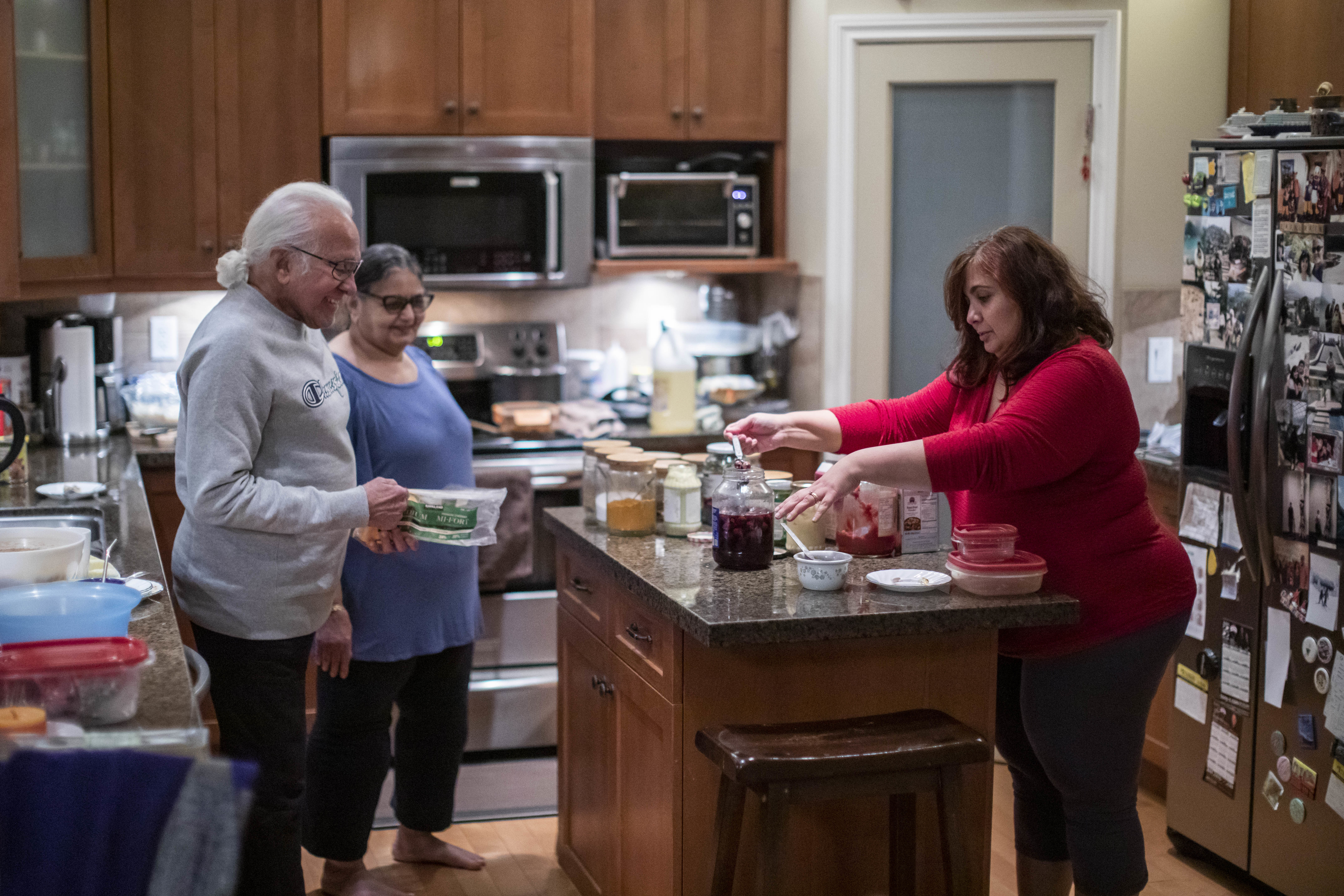 Lakhani's father-in-law and mother-in-law have their own living space in the basement. But the family regularly comes together to cook. (Ben Nelms/CBC)