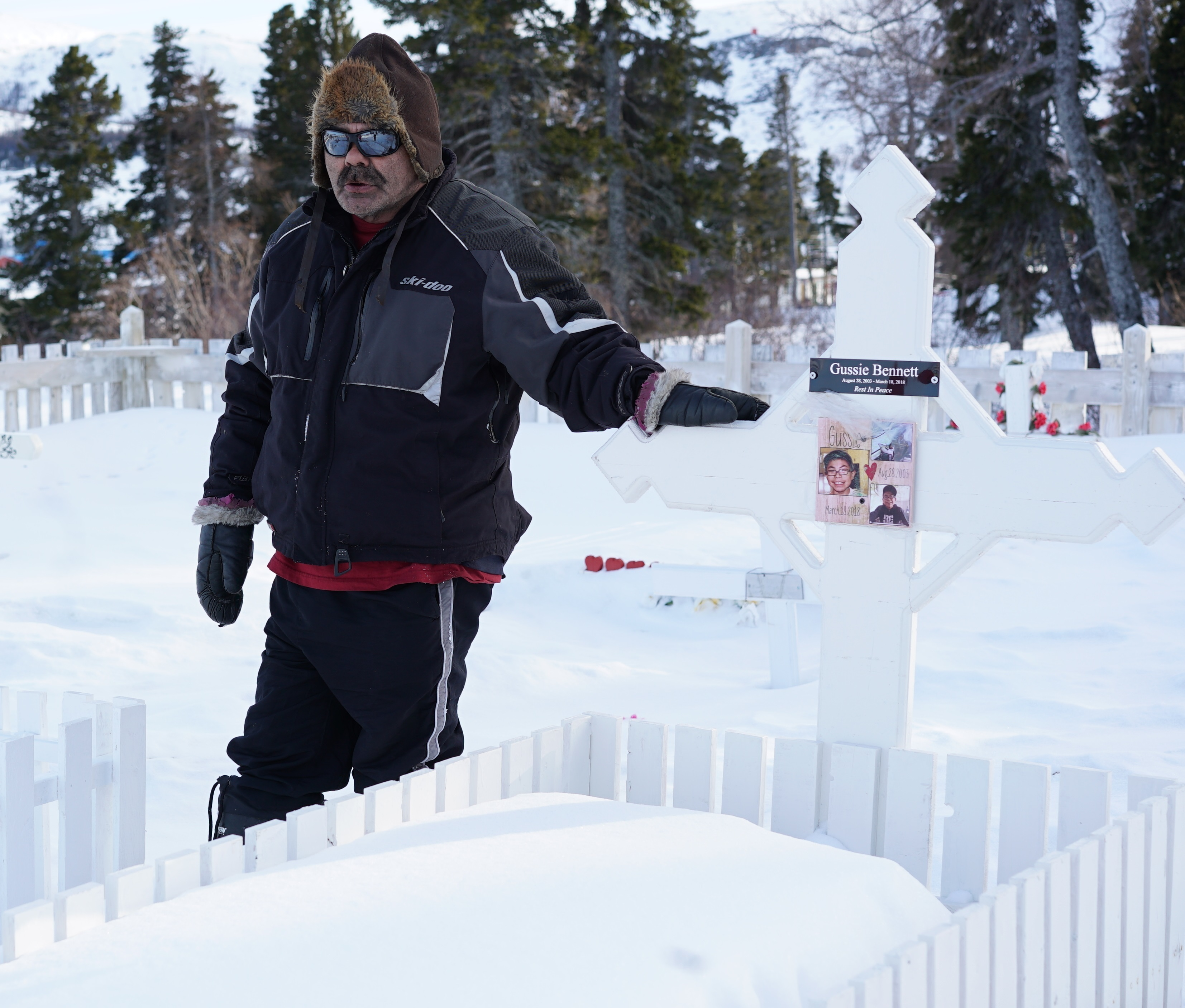 Jim Bennett at his son's grave. (Ossie Michelin/CBC)