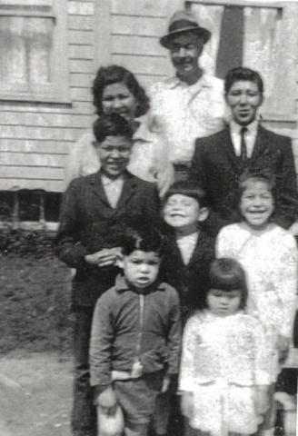 Judy Clark shown as a young girl, smiling at middle right, with her family on Lennox Island. (Submitted by Judy Clark)