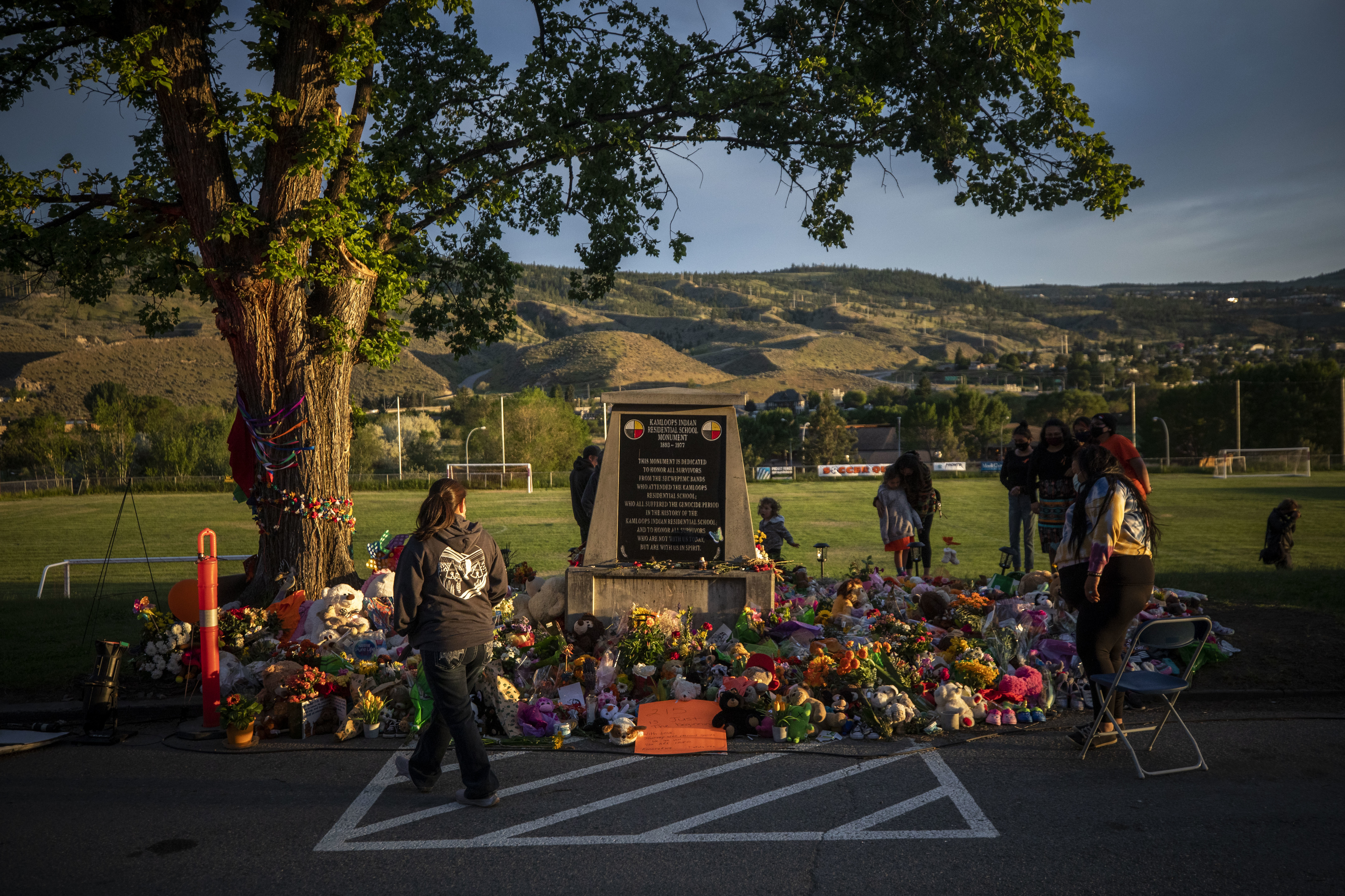 The sun sets on the memorial outside of the former Kamloops Indian Residential School.