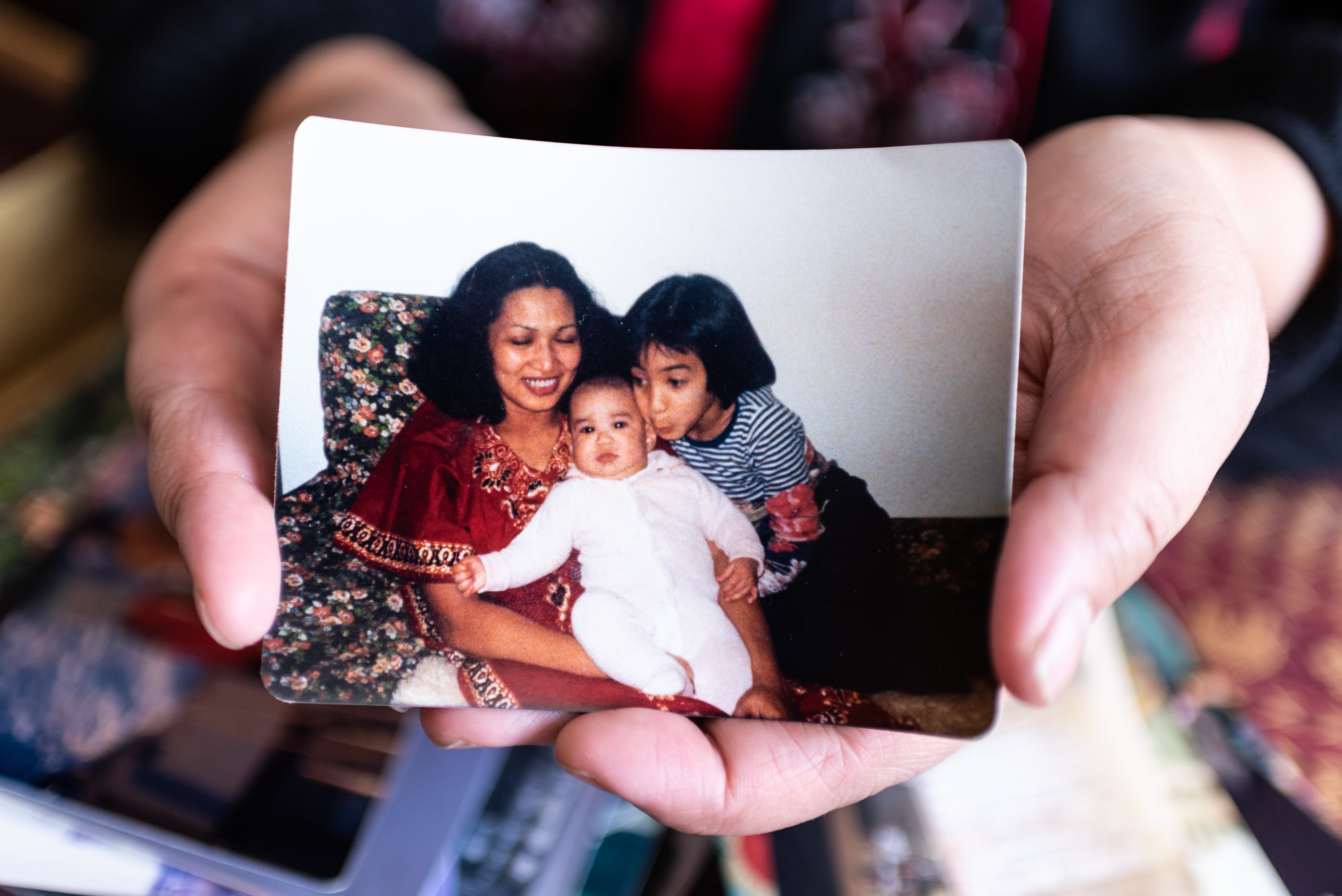 Kris Alvarez holds a picture of herself as an eight-year-old with her mother, Susan, and her brother Joe. The family moved to Regina in 1974 (Michael Bell).