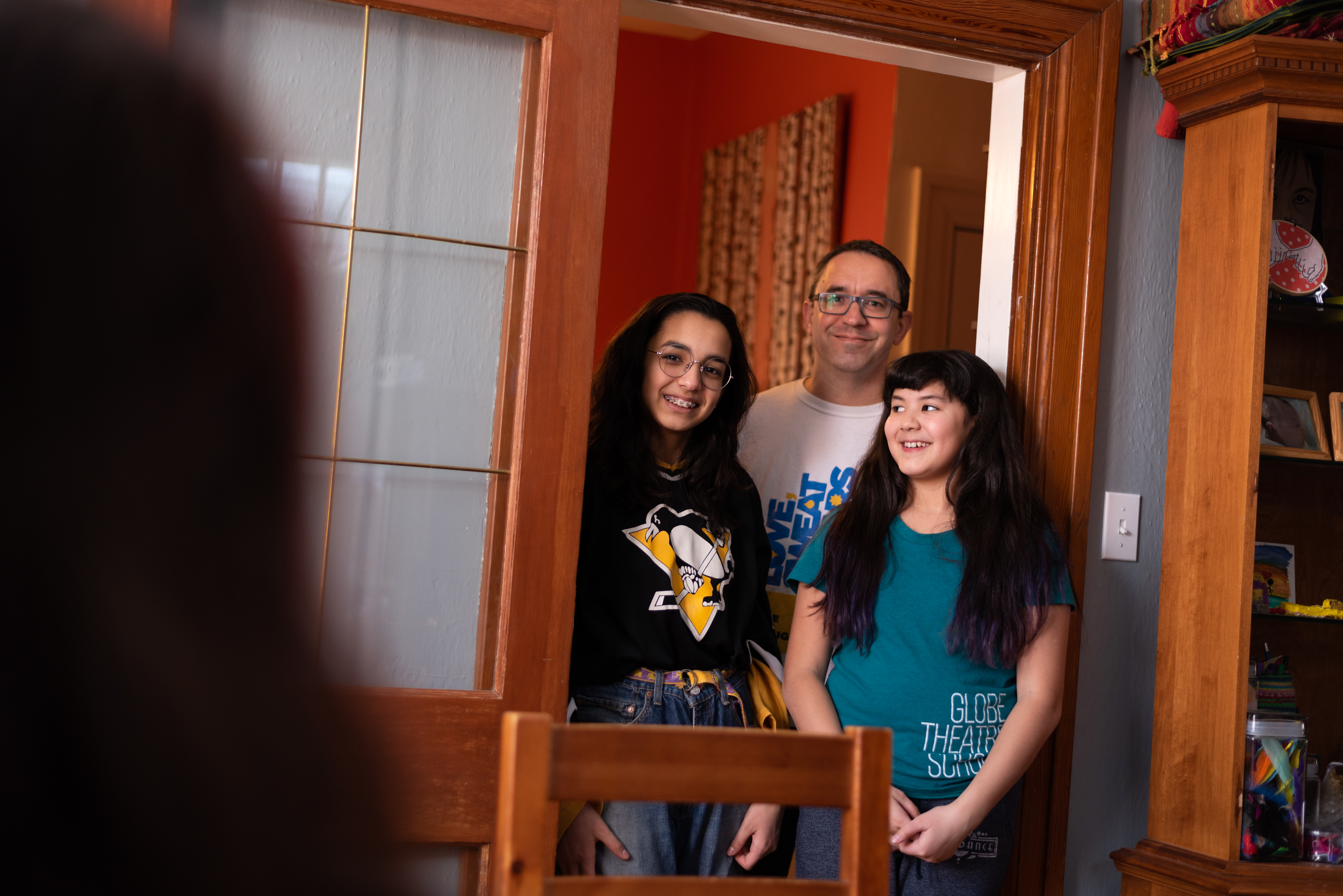 Pictured (left to right) is Kris Alvarez's daughter Zo' James, husband, Eric James, and daughter Iris James at their home in Regina (Michael Bell).
