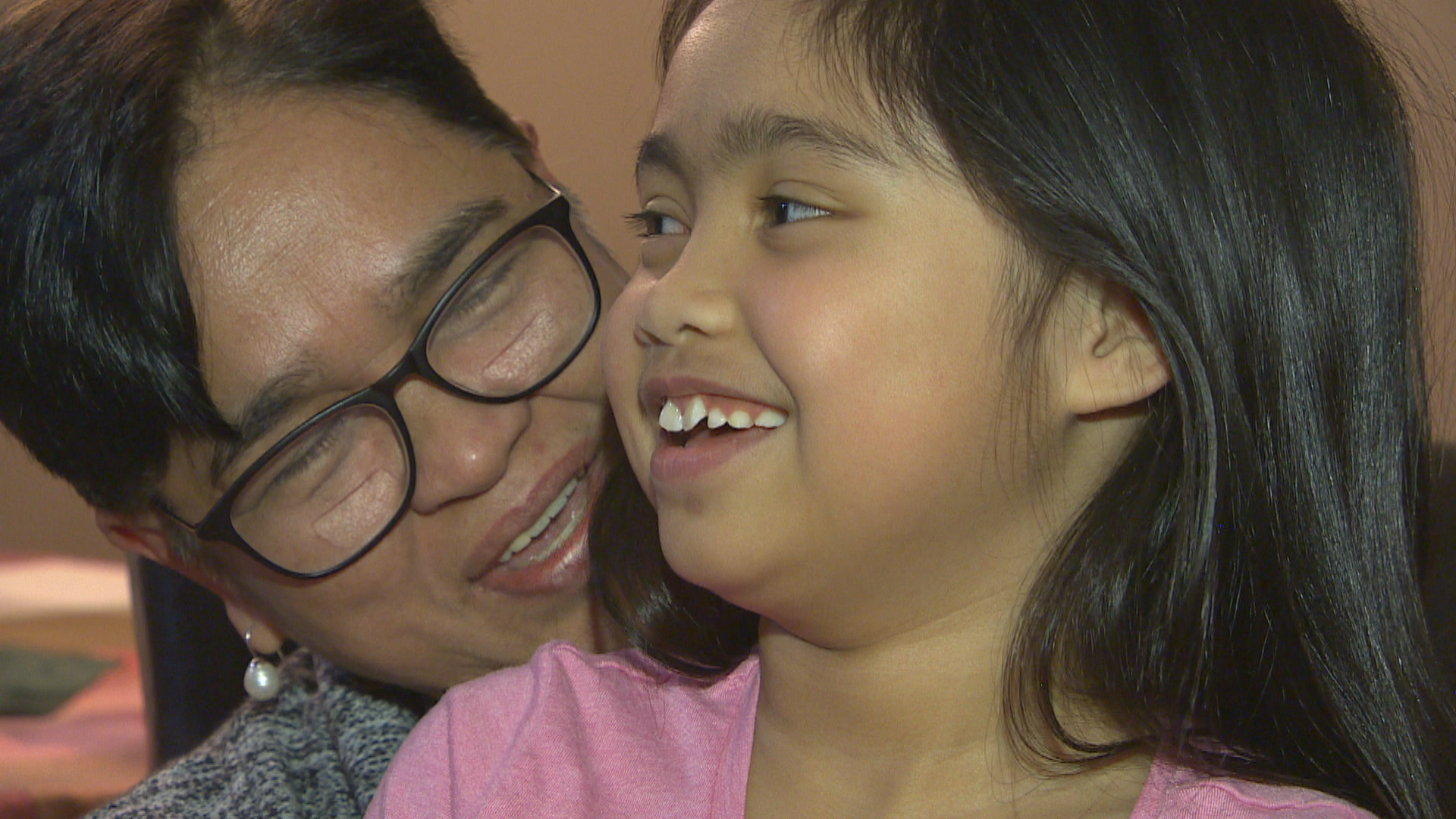 Lexie Ontong, 7, sits with her grandmother, Angelita Ontong. (Travis Golby/CBC)