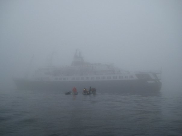 Passengers disembark from the Lyubov Orlova on inflatable Zodiaks on a foggy day off the coast of Newfoundland in 2008. (Randi Beers)