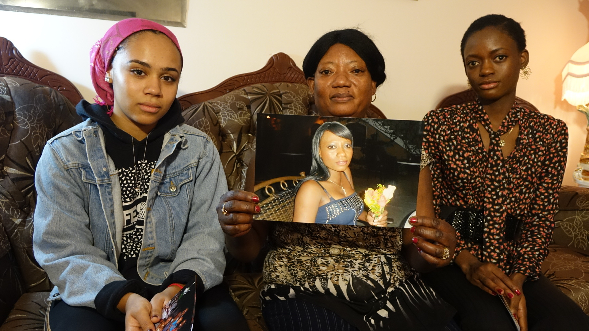 Fabiola's mother Marie-Pierre Philippe (centre) with her granddaughter Lydia (left) and daughter Marie-Oubline (right). (Jean Delisle/CBC)