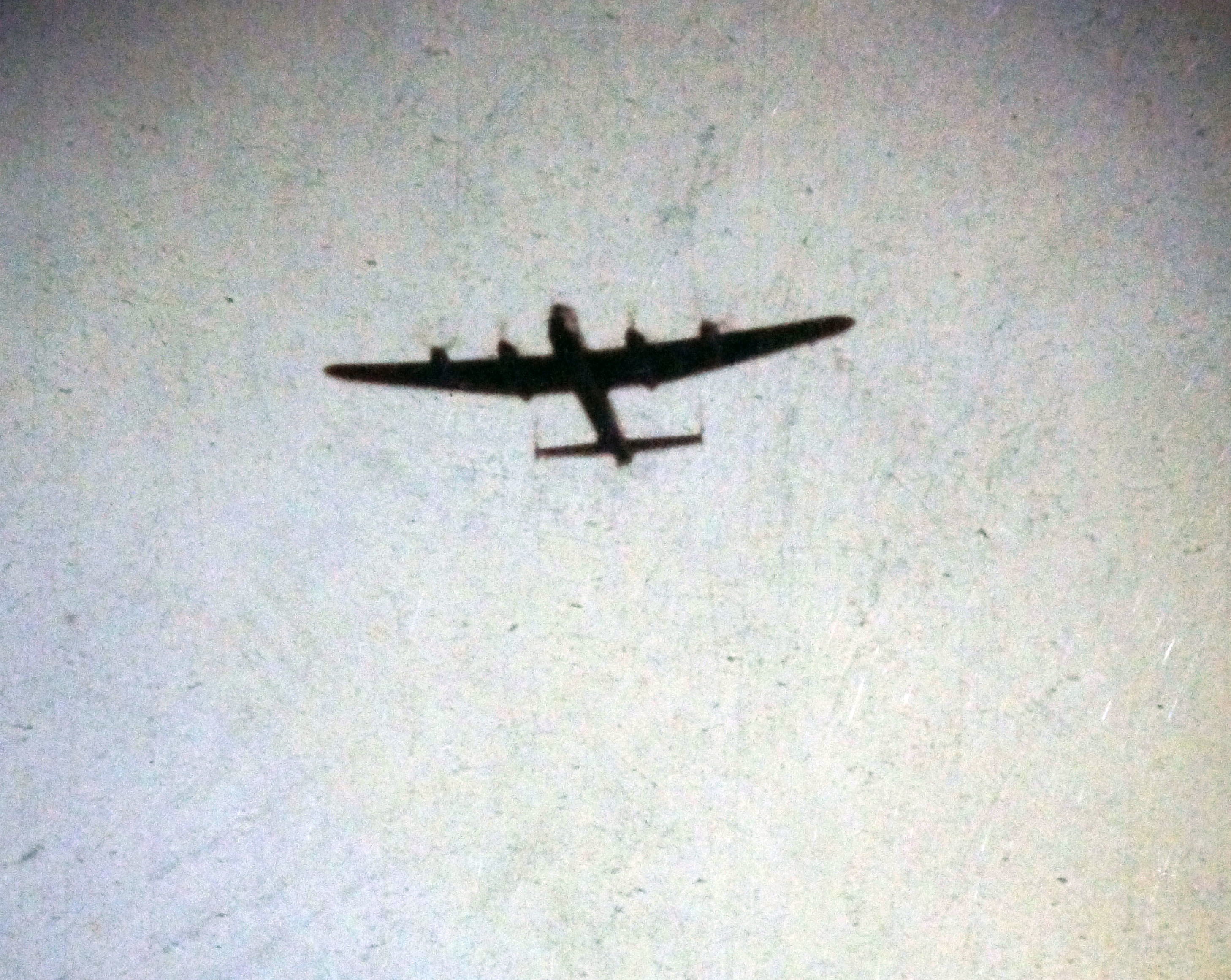 Lancaster 965 is shown in the air above the base at Alert just before the crash. (J Peter Johnson / Submitted by Richard Mayne / RCAF)