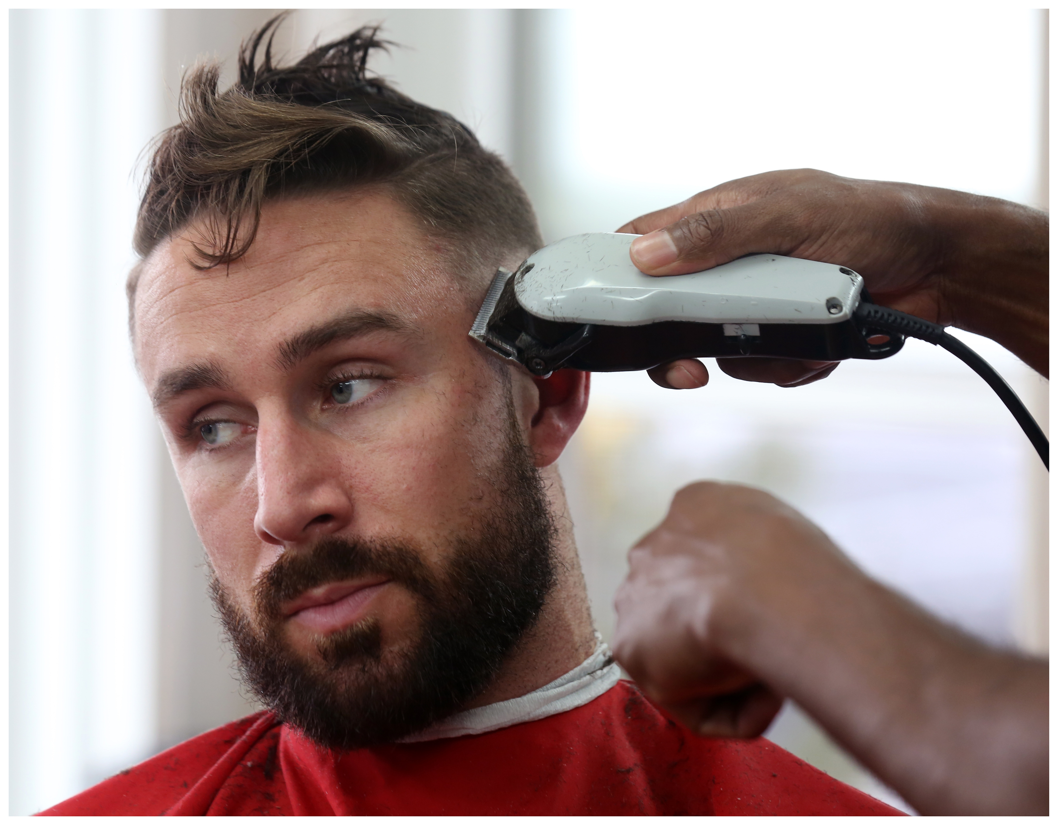 Patron Liam Condon gets a haircut  at the 1949 Barber Shop on Mayor Avenue.  (Paul Daly)