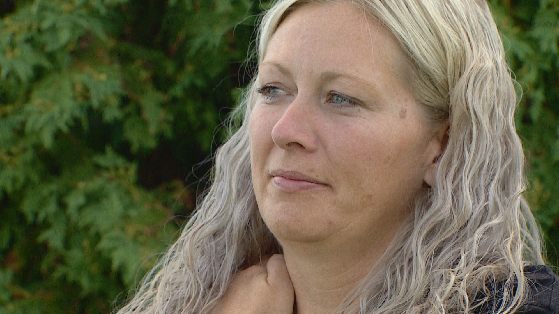 Lindsay Niwa tears up when speaking about her brother, Brandon, who died on May 29, 2020. (Monty Kruger/CBC)