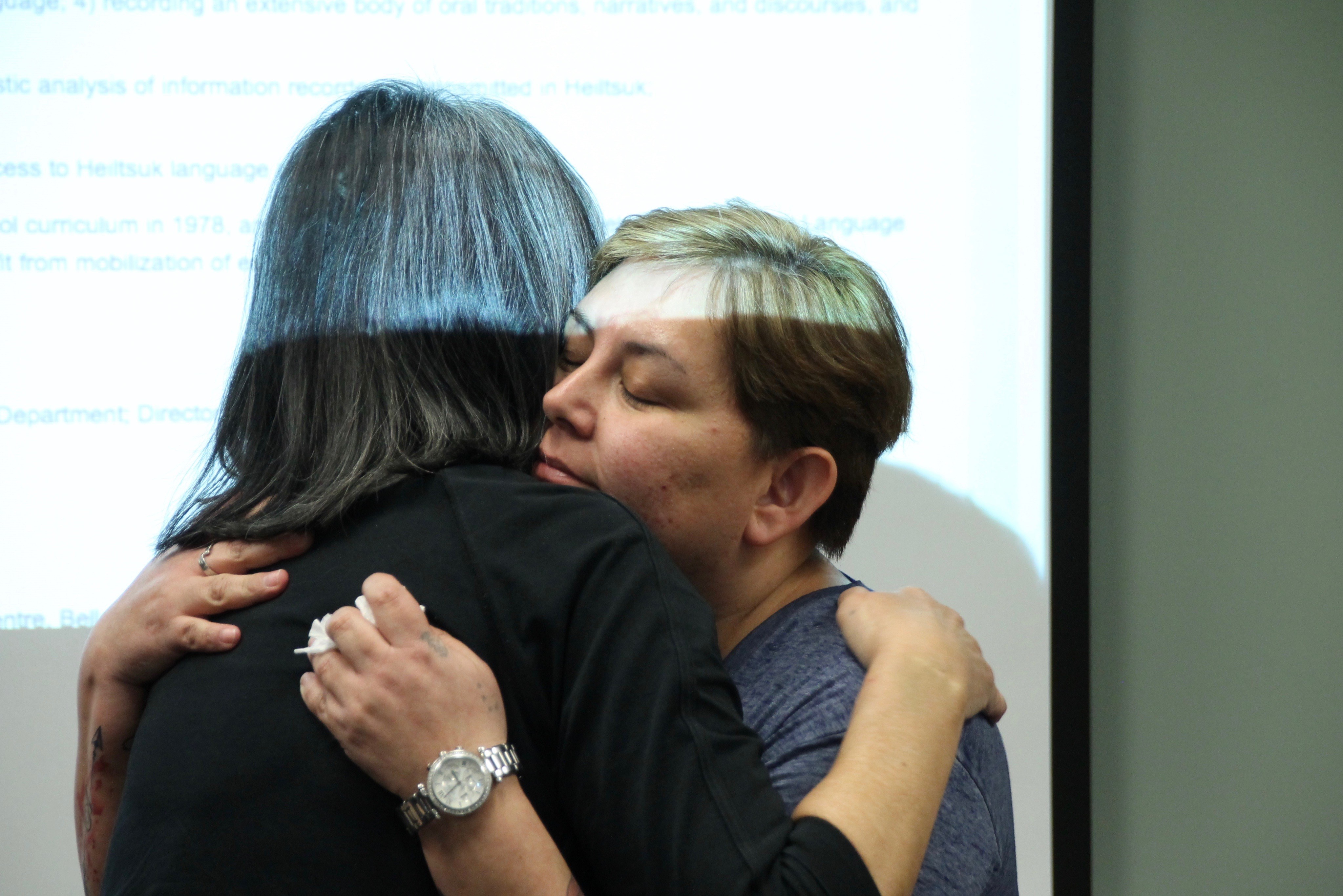 Instructor Elizabeth Wilson, right, embraces student Wanda Christianson at a Hailhzaqvla class in Vancouver. (Rehmatullah Sheikh/V.S. Wells)