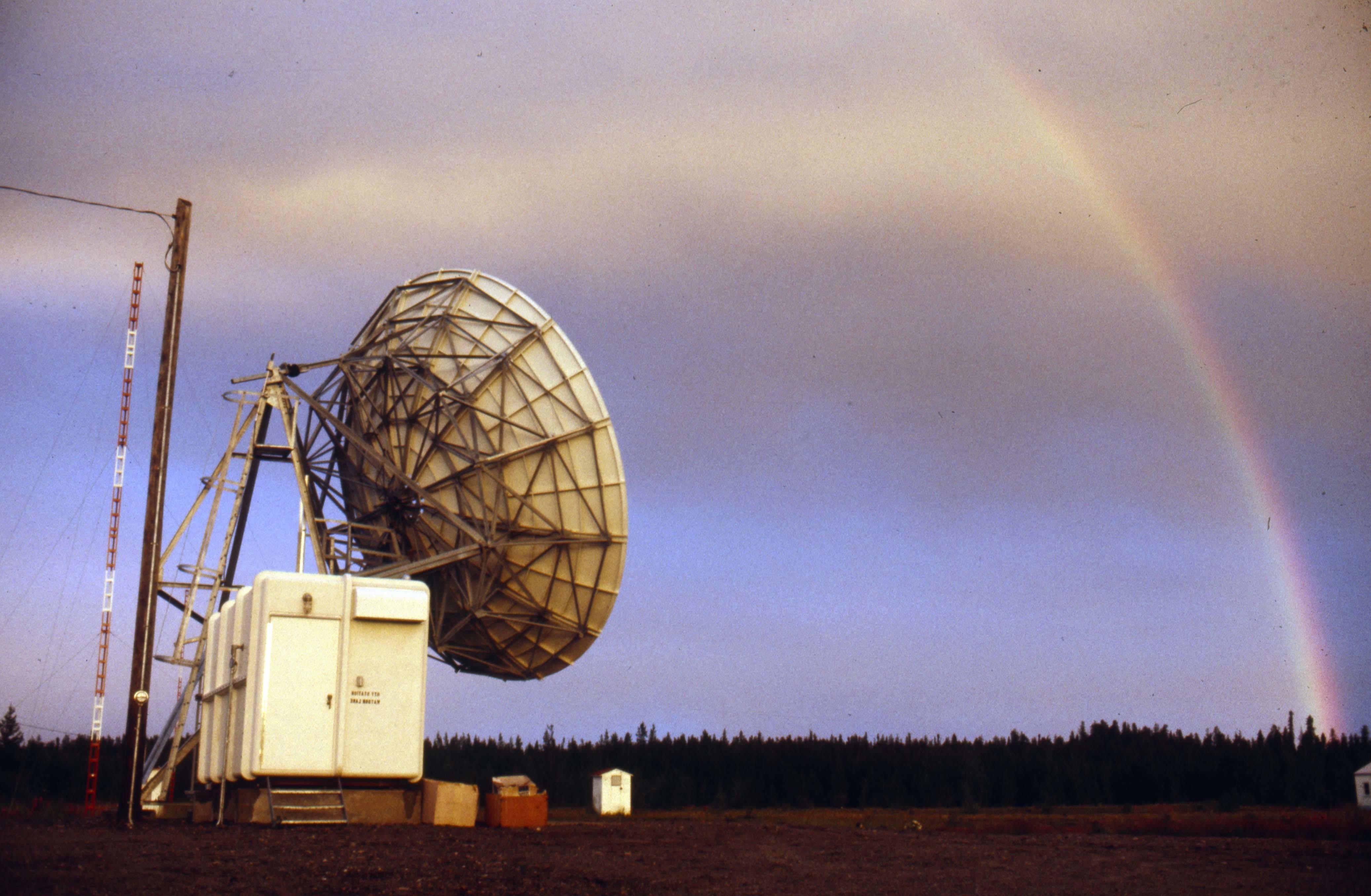A rainbow shines over a Telesat dish and TV tower in Yukon. (Tim Kinvig)