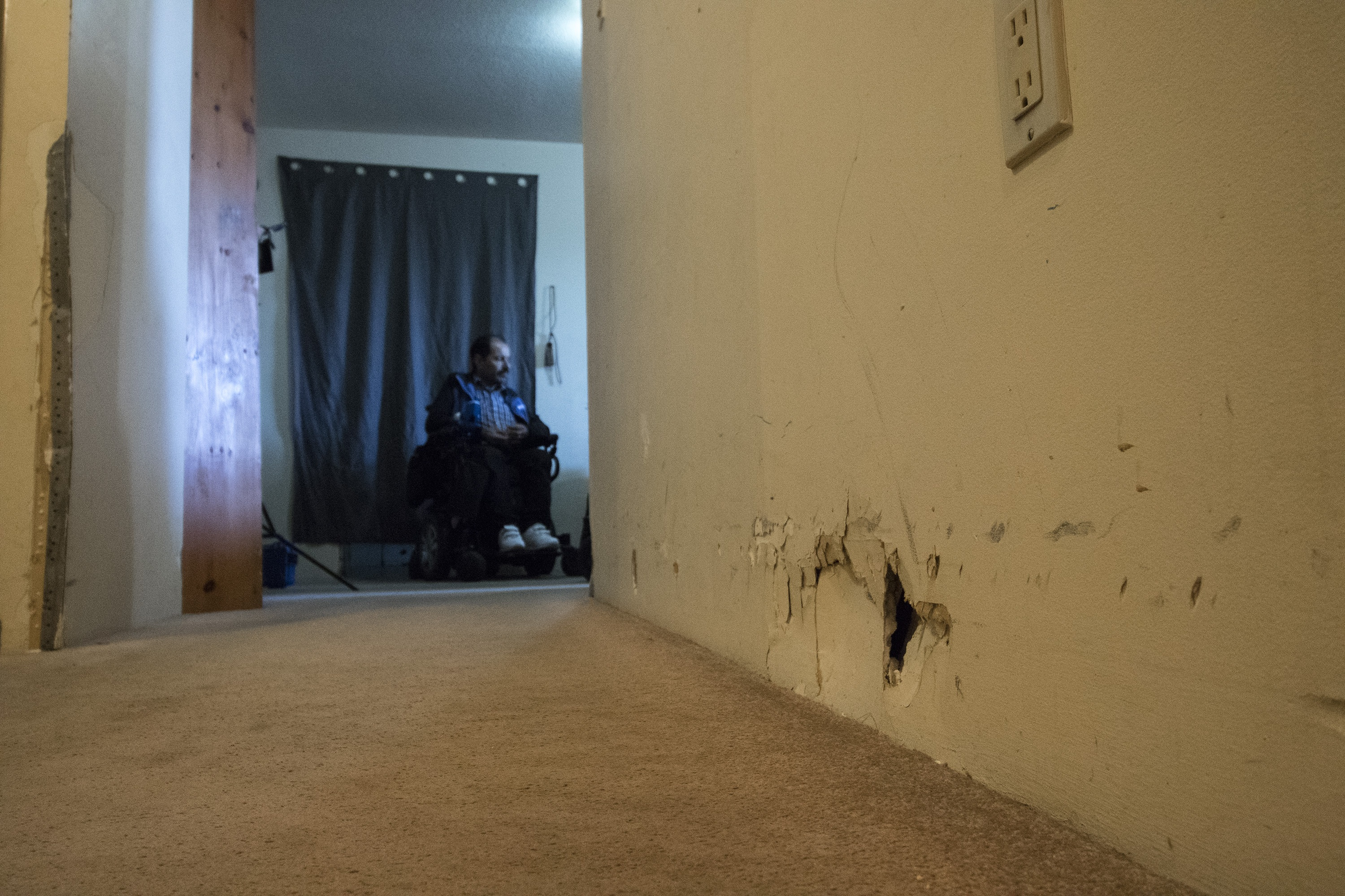 The hallway leading to the living room. Mohammad is seen in the background. (Dave Irish/CBC)